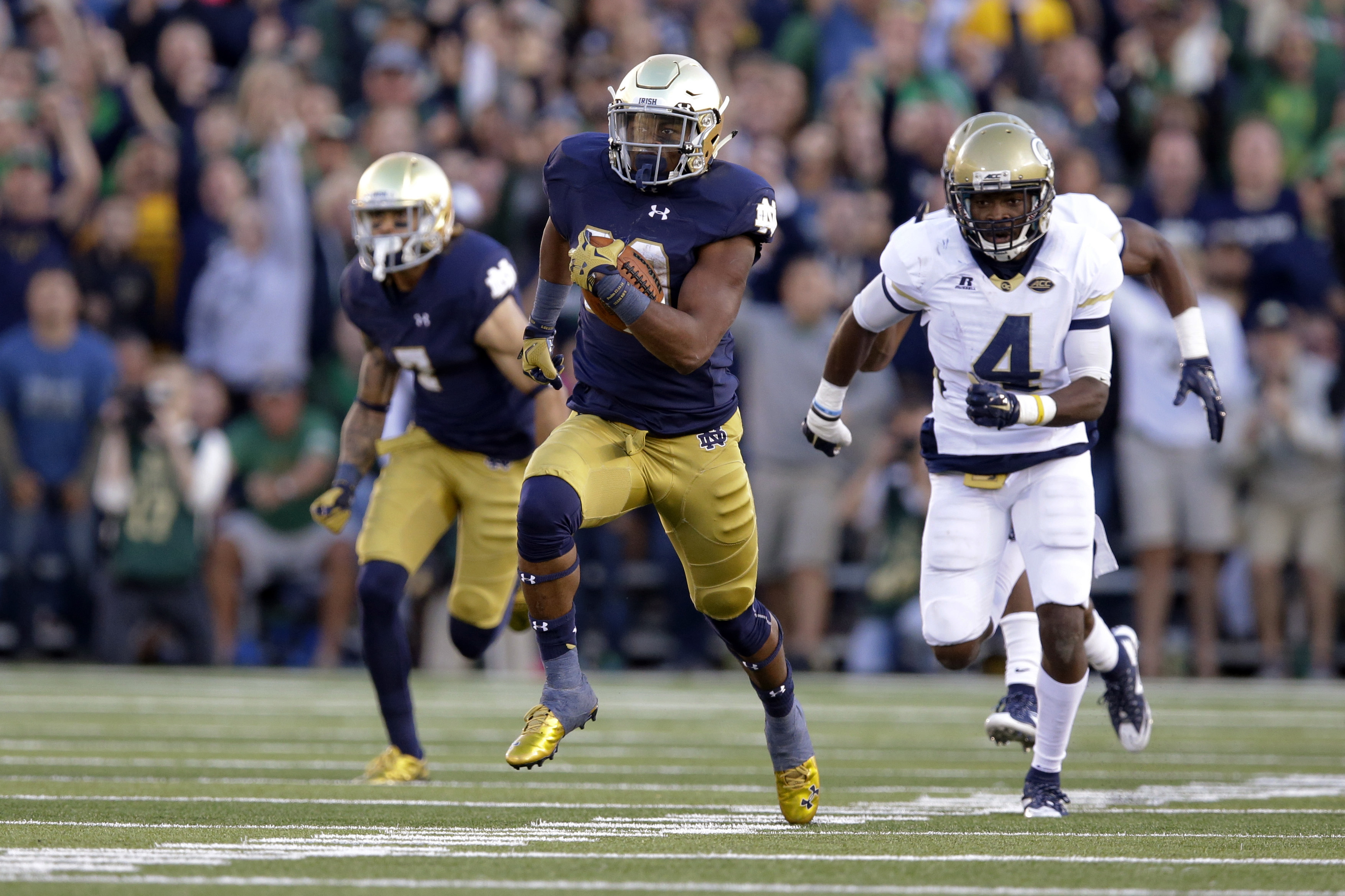 Notre Dame running back C.J. Prosise (20) runs past Georgia Tech defensive back Jamal Golden (4) for a touchdown during the second half of an NCAA college football game in South Bend, Ind., Saturday, Sept. 19, 2015. Notre Dame defeated Georgia Tech 30-22.