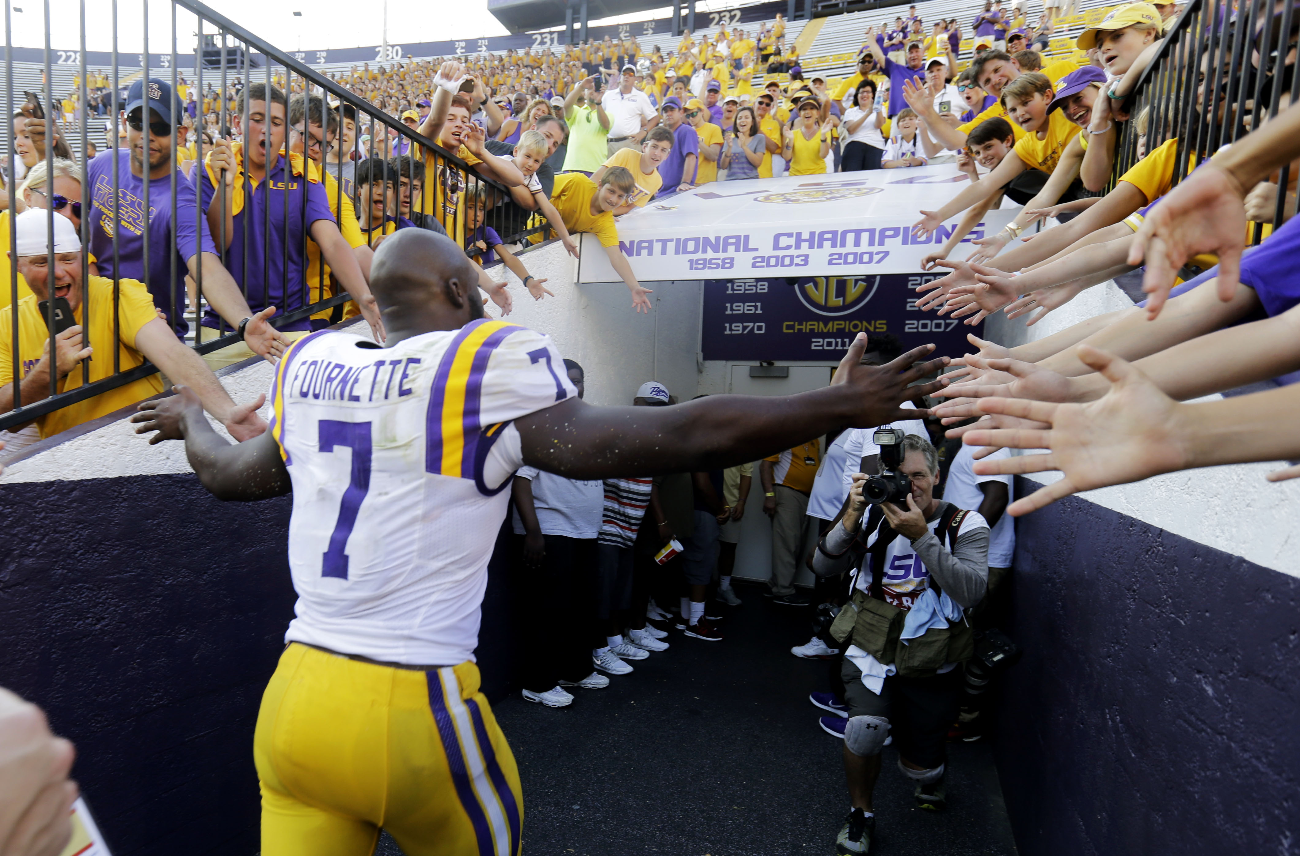 LSU running back Leonard Fournette (7) greets fans as he runs off the field after an NCAA college football game against Auburn in Baton Rouge, La., Saturday, Sept. 19, 2015. Fournette had 228 rushing yards, nine receiving yards, and three touchdowns as LS