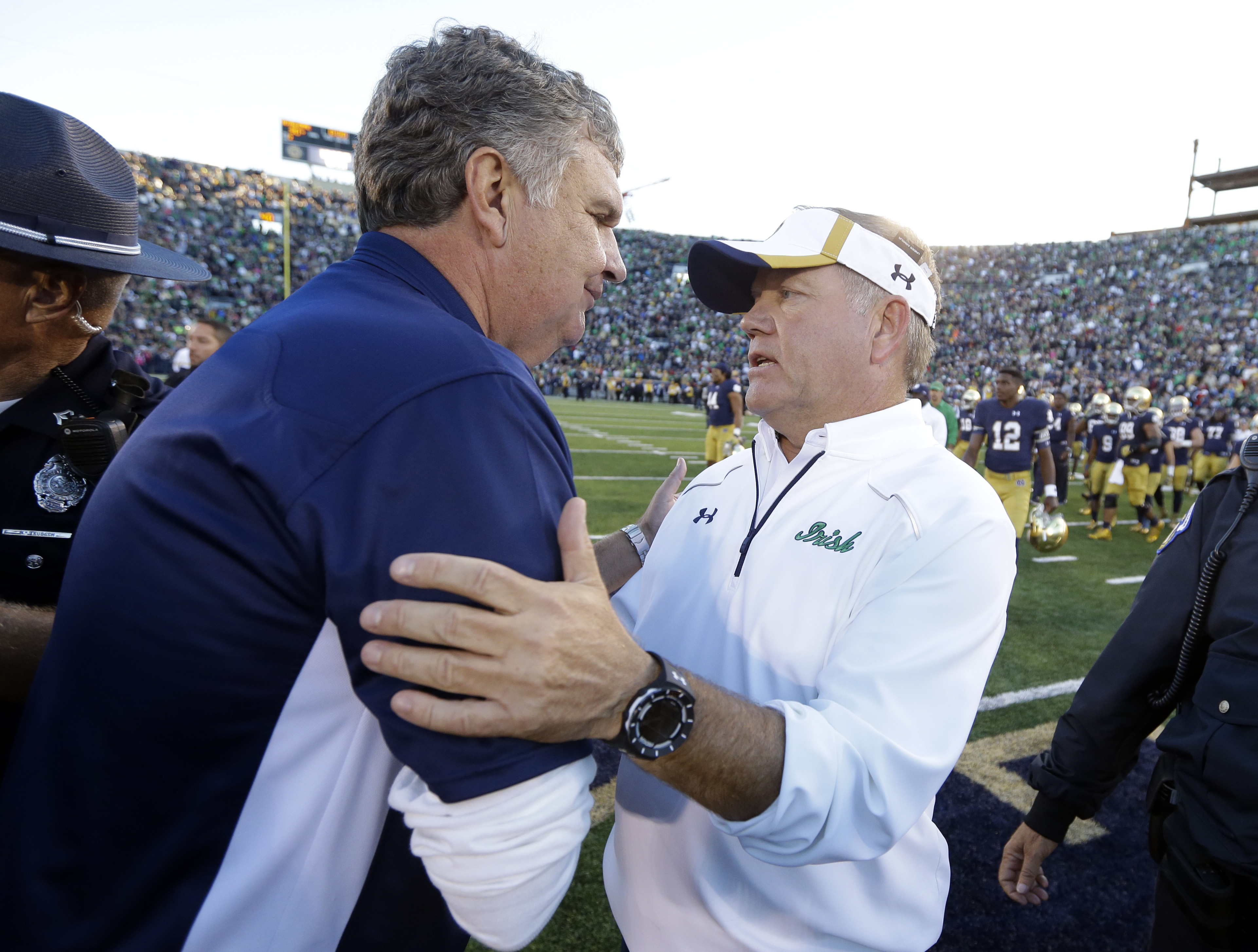 Notre Dame coach Brian Kelly, right, is greeted by Georgia Tech coach Paul Johnson following an NCAA college football game in South Bend, Ind., Saturday, Sept. 19, 2015. Notre Dame defeated Georgia Tech 30-22. (AP Photo/Michael Conroy)