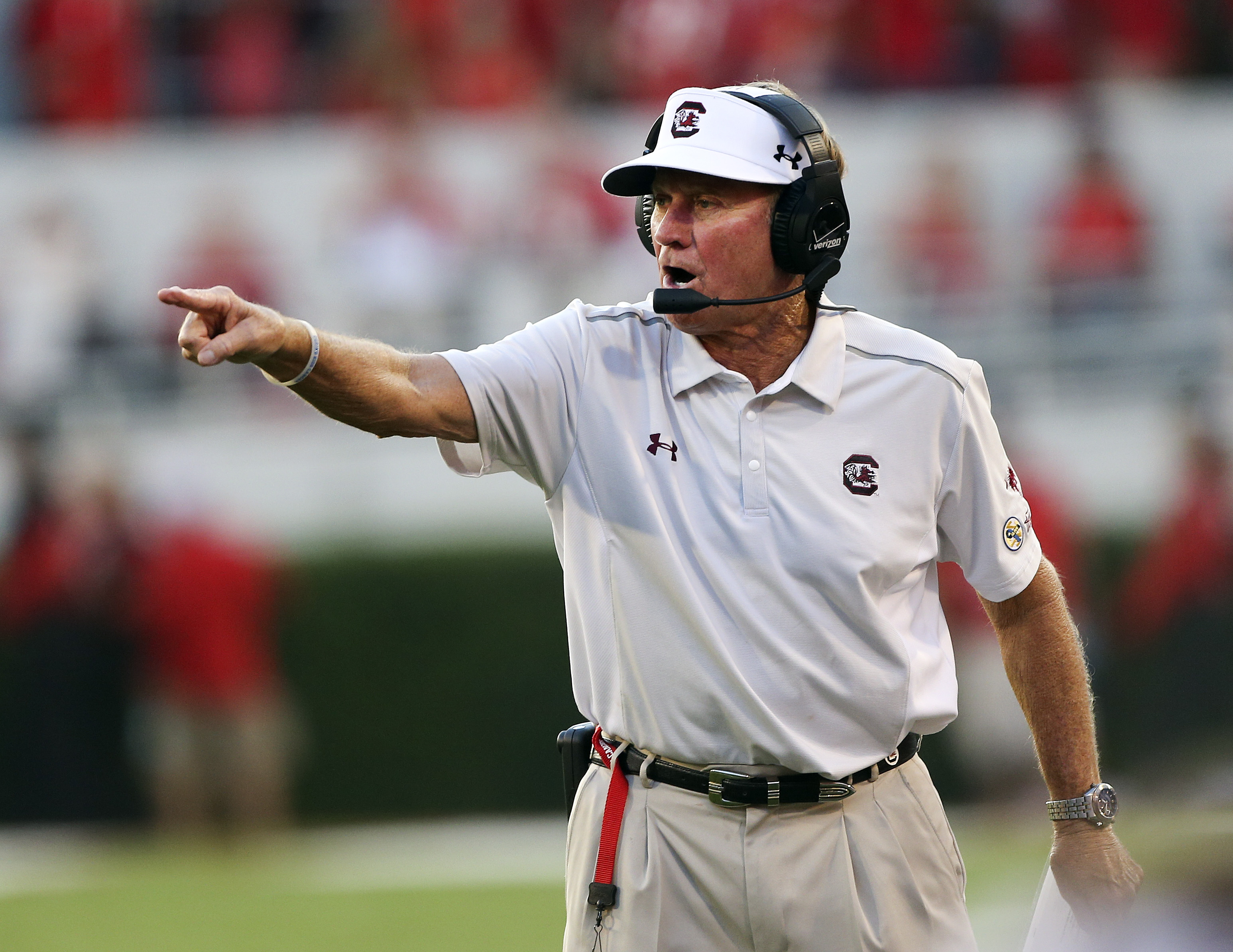 South Carolina coach Steve Spurrier motions to his team from the sideline during the first half of an NCAA college football game against Georgia on Saturday, Sept. 19, 2015, in Athens, Ga. (AP Photo/John Bazemore)