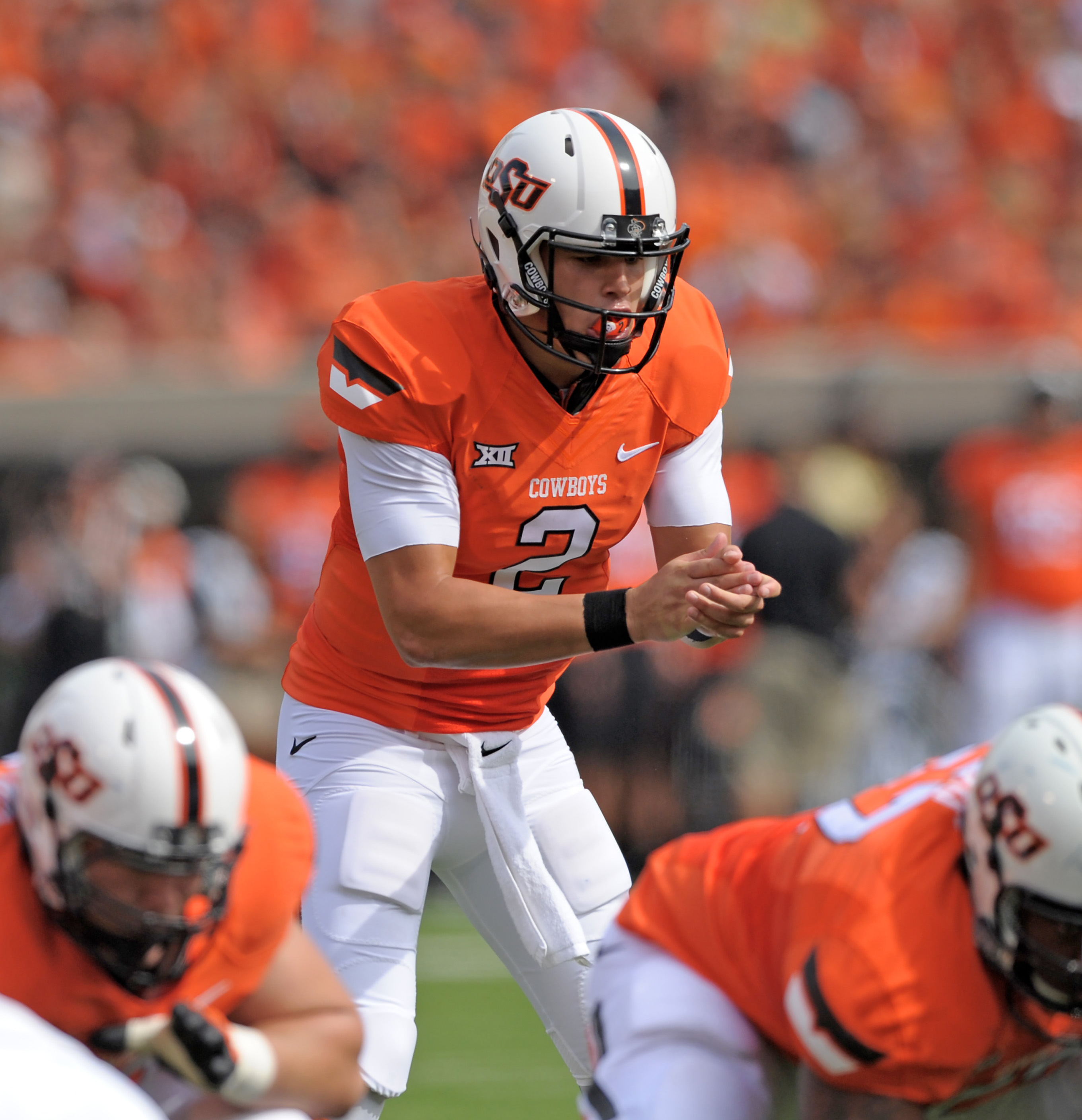 Oklahoma State quarterback Mason Rudolph lines up for the snap during an NCAA college football game in Stillwater, Okla., Saturday, Sept. 19, 2015. Rudolph completed 17 of 23 passing attempts for a total of 280 yards in the Oklahoma State 69-14 win over U