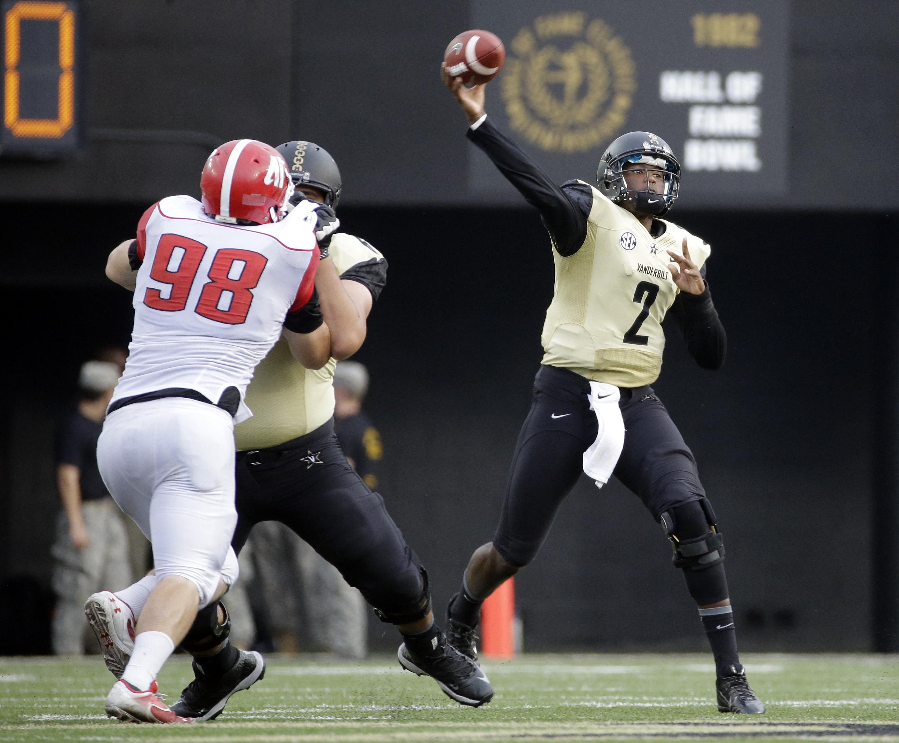 Vanderbilt quarterback Johnny McCrary (2) passes as Austin Peay defensive tackle Branden Johnson (98) rushes in the second half of an NCAA college football game, Saturday, Sept. 19, 2015, in Nashville, Tenn. Vanderbilt won 47-7. (AP Photo/Mark Humphrey)