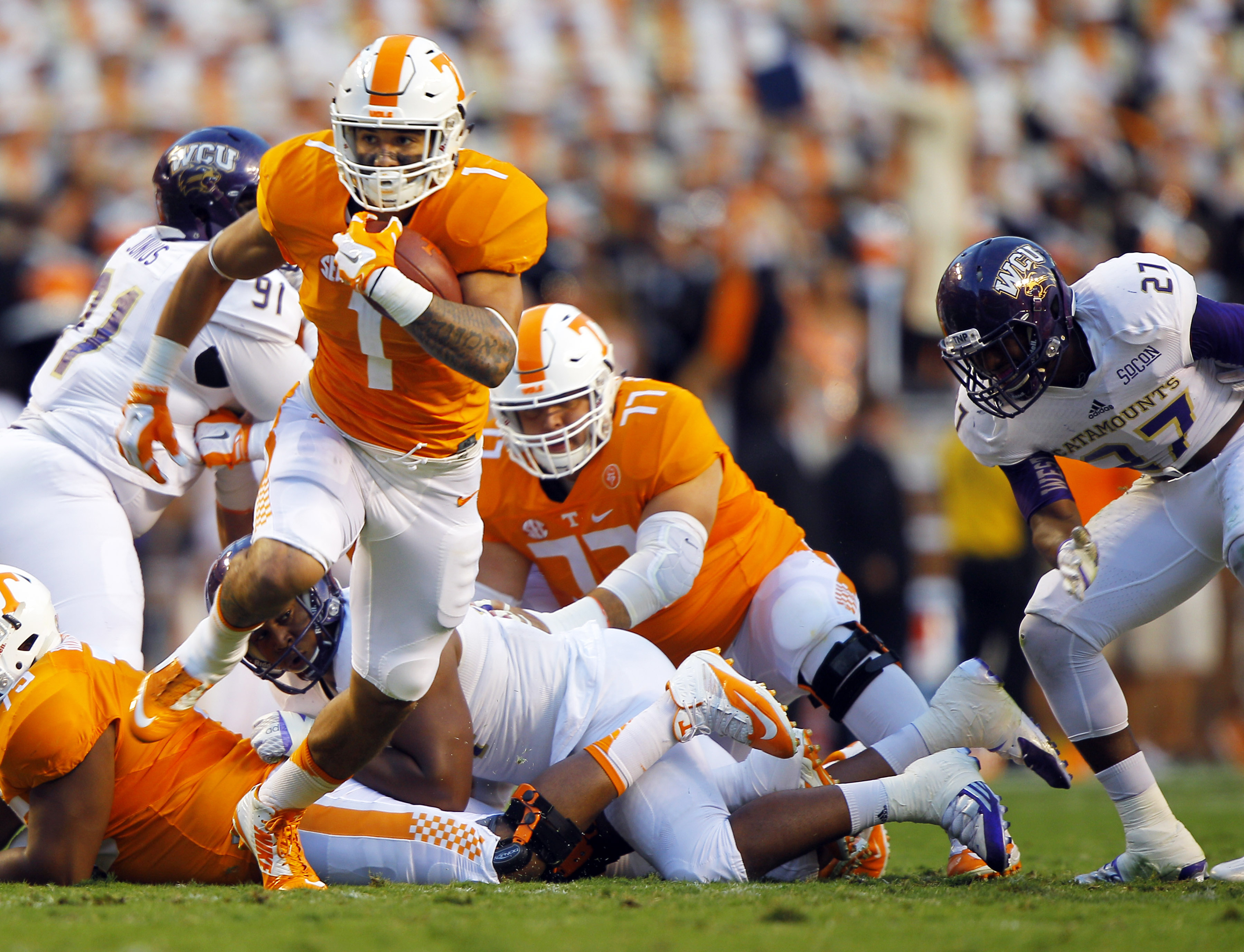 Tennessee running back Jalen Hurd (1) rushes for yardage during the first half of an NCAA college football game against Western Carolina Saturday, Sept. 19, 2015, in Knoxville, Tenn. (AP Photo/Wade Payne)