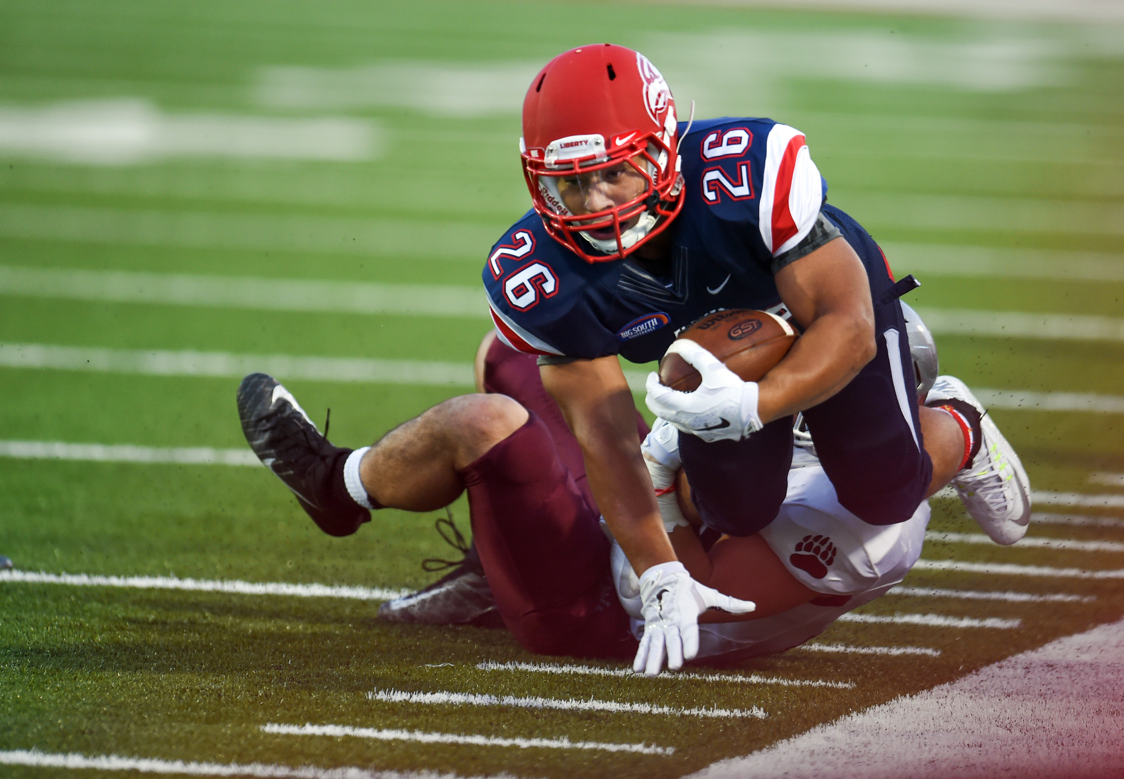 Liberty University running back Desmond Rice dives for a first down during an NCAA college football game against Montana, Saturday, Sept. 19, 2015, in Lynchburg, Va.  (AP Photo/Lee Luther Jr.)