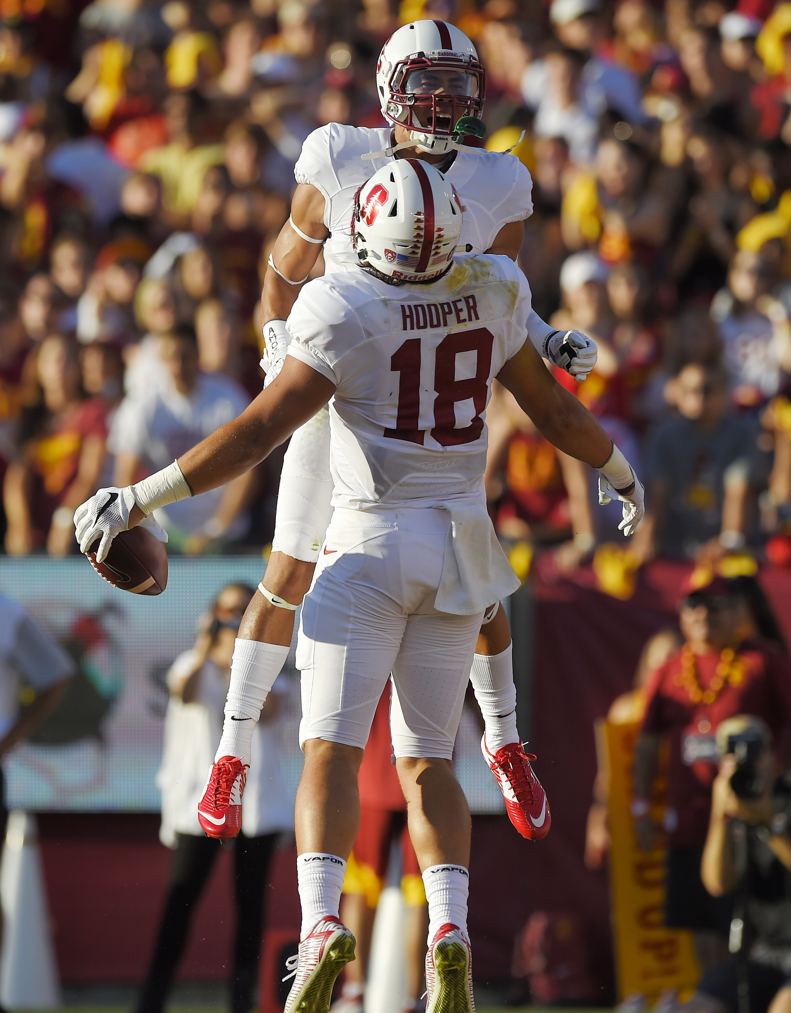 Stanford tight end Austin Hooper, below, celebrates along with wide receiver Michael Rector after scoring a touchdown during the first half of an NCAA college football game against Southern California, Saturday, Sept. 19, 2015, in Los Angeles. (AP Photo/M