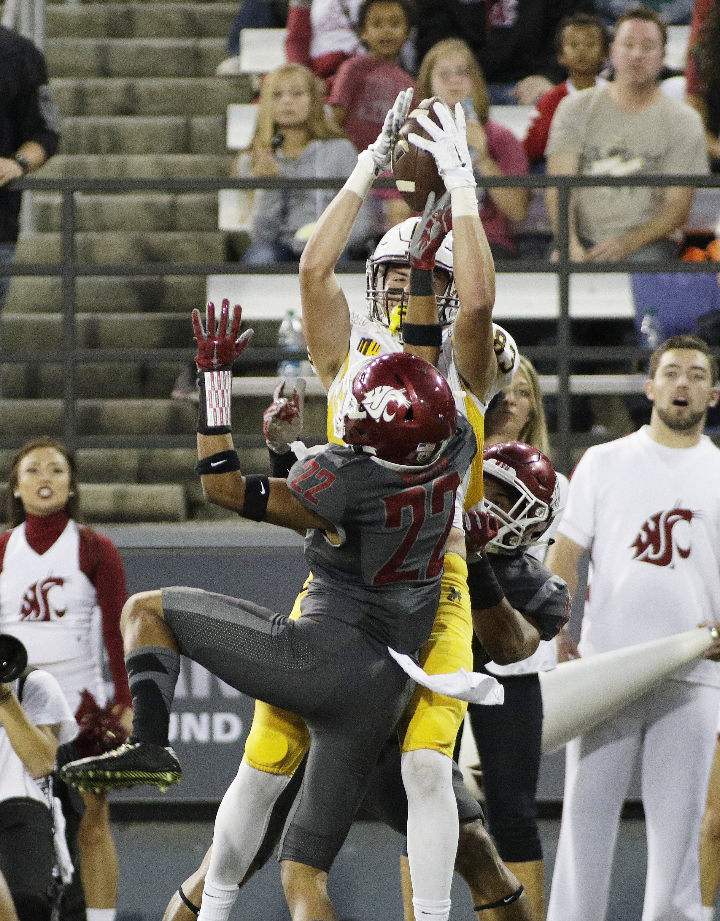 Wyoming wide receiver Jake Maulhardt (83) makes a catch against Washington State cornerback Darrien Molton (22) and Shalom Luani during the first half of an NCAA college football game, Saturday, Sept. 19, 2015, in Pullman, Wash. (AP Photo/Young Kwak)