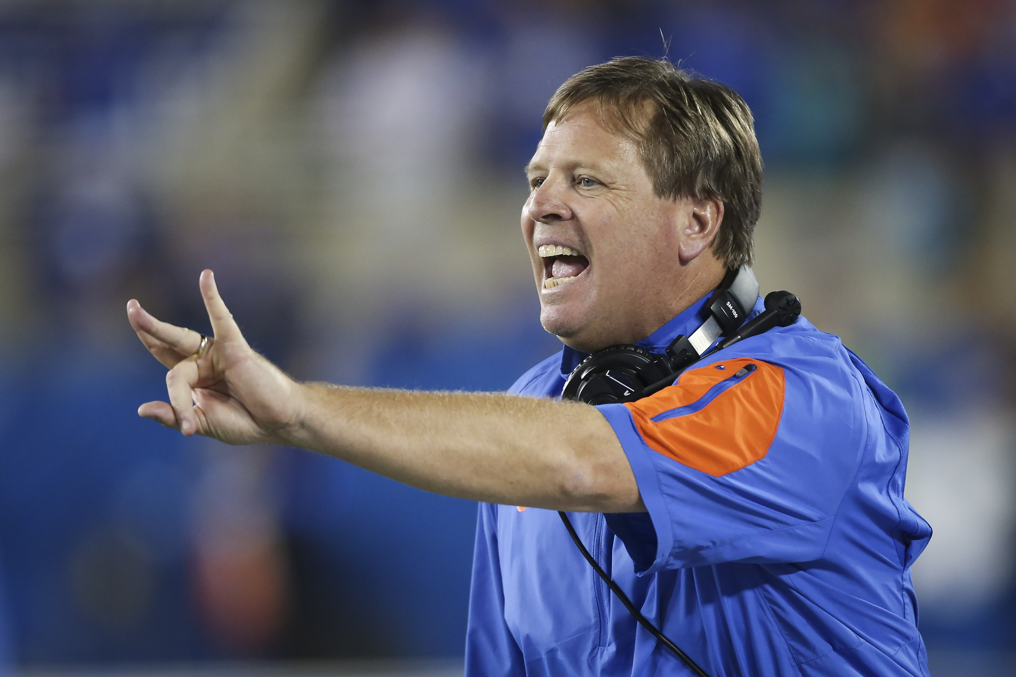 Florida head coach Jim McElwain instructs his team during the second half of an NCAA college football game against Kentucky, Saturday, Sept. 19, 2015, in Lexington, Ky. Florida won the game 14-9. (AP Photo/David Stephenson)