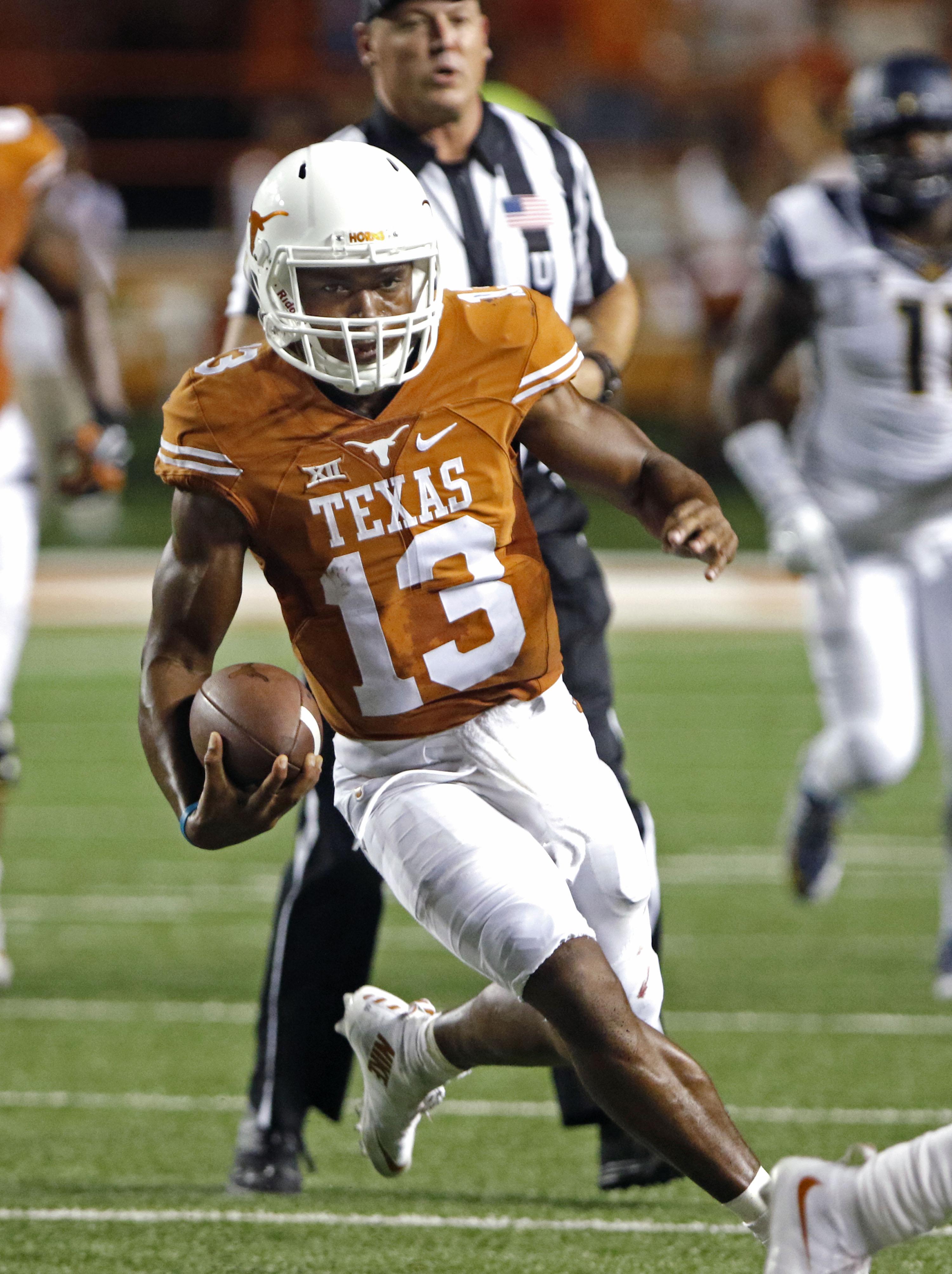 Texas quarterback Jerrod Heard (13) runs for a touchdown during the second half of an NCAA college football game against California, Saturday, Sept. 19, 2015, in Austin, Texas. (AP Photo/Michael Thomas)