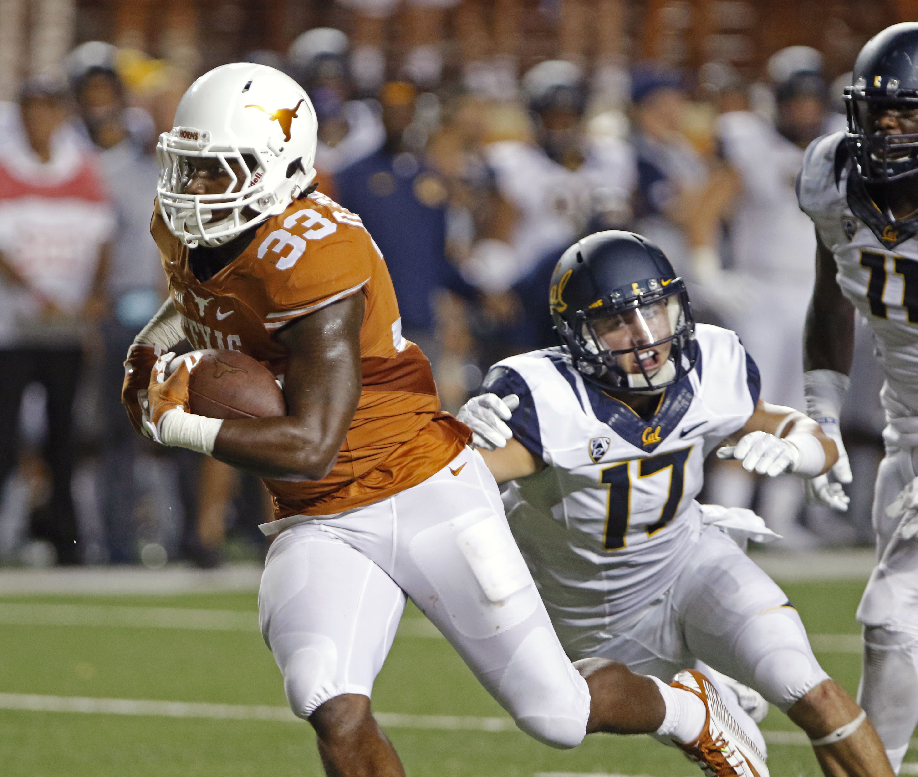 Texas running back D'Onta Foreman (33) runs for a touchdown against California's Luke Rubenzer (17) during the second half of an NCAA college football game, Saturday, Sept. 19, 2015, in Austin, Texas. (AP Photo/Michael Thomas)