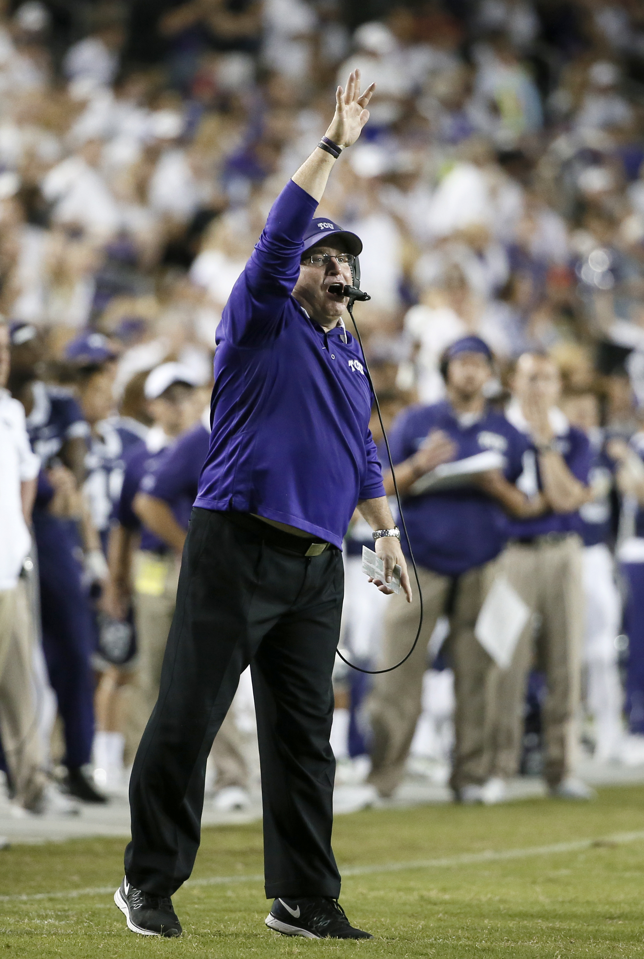 TCU head coach Gary Patterson signals to his defense in the second half of an NCAA college football game against SMU, Saturday, Sept. 19, 2015, in Fort Worth, Texas. (AP Photo/Tony Gutierrez)