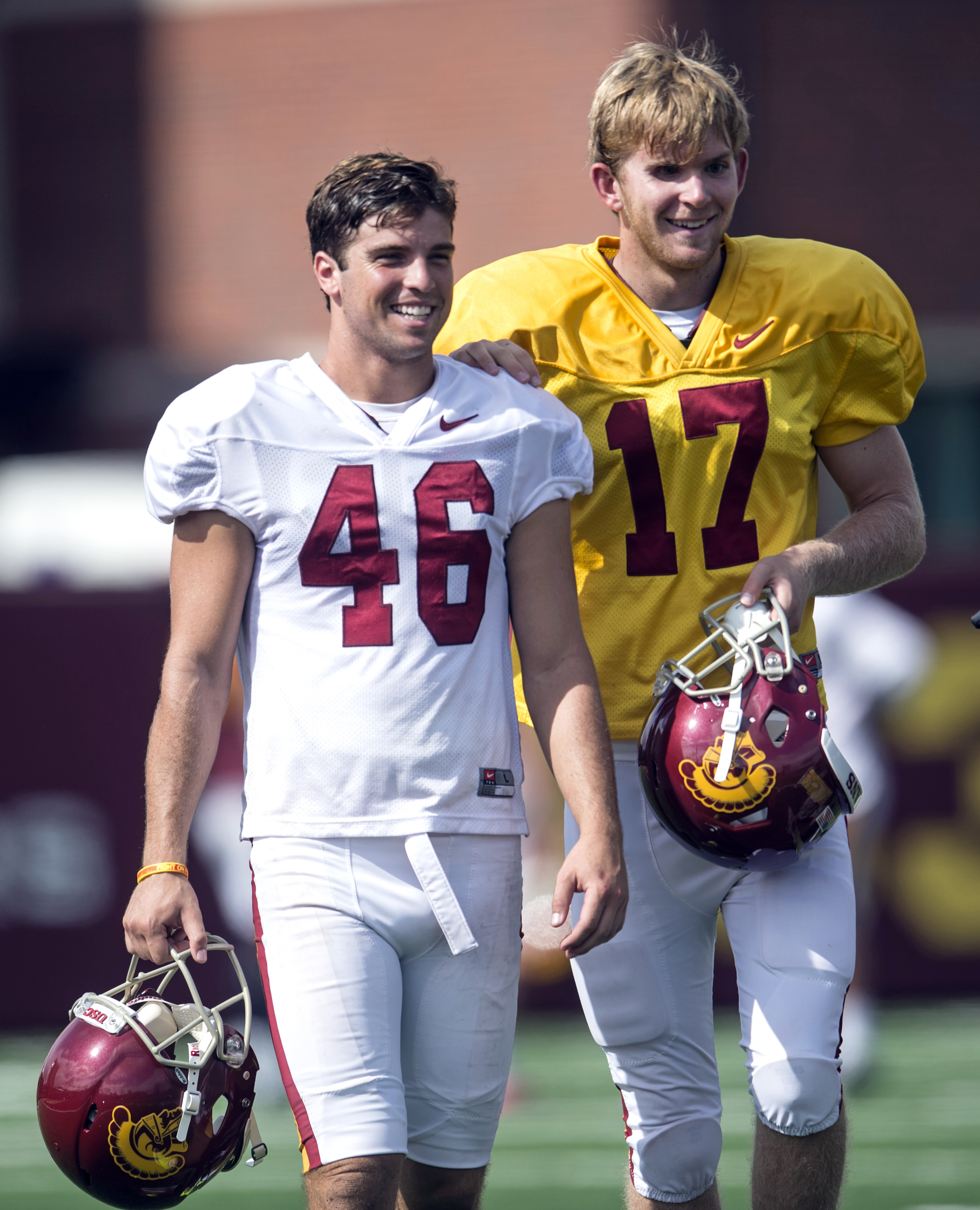 FILE - In this Sept. 15, 2015, file photo, Jake Olson, right, is guided on the field by Southern California teammate Reid Budrovich during NCAA college football practice at USC Los Angeles. On Saturday, Sept. 19, 2015, Olson stood with his USC teammates o