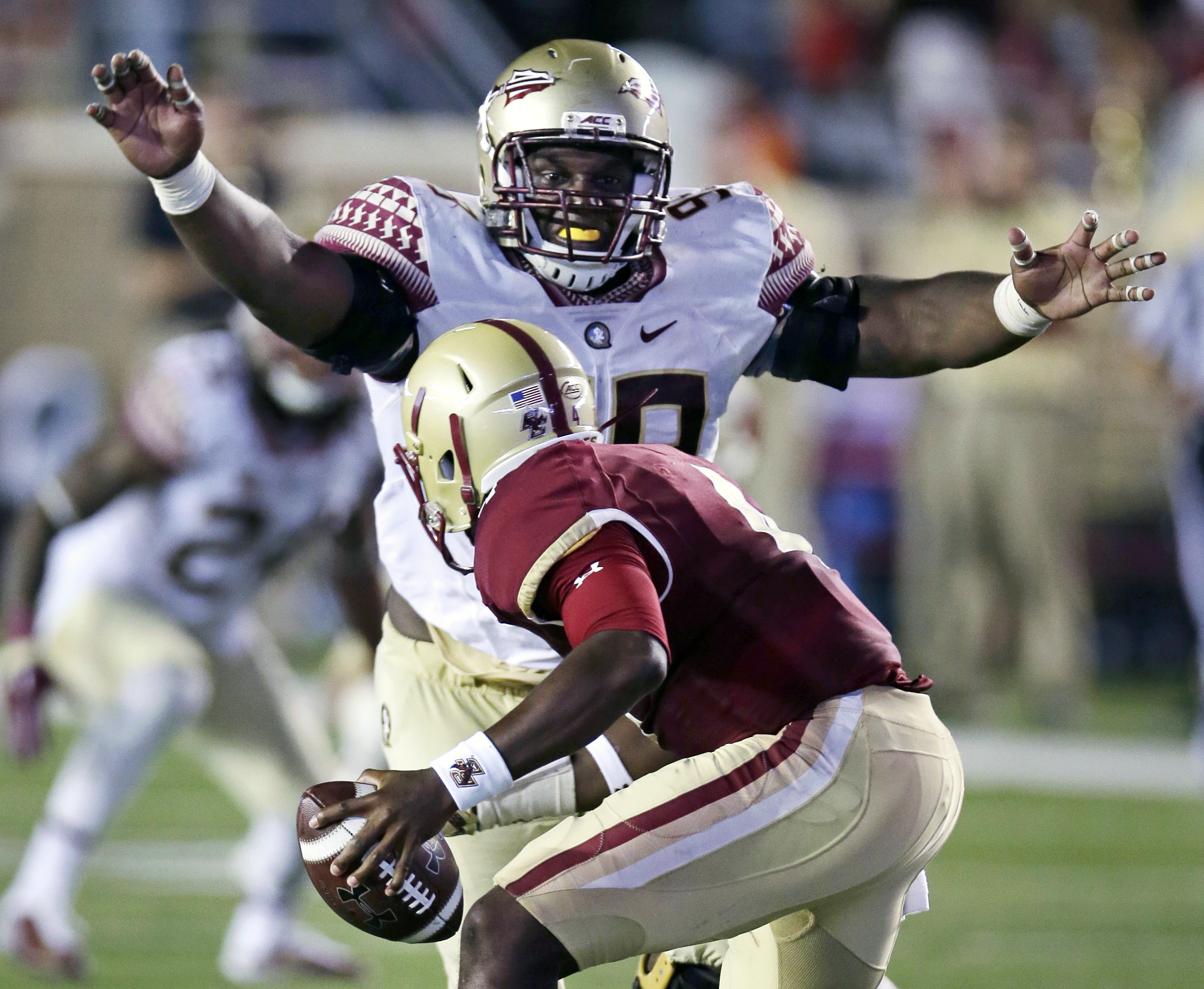 FILE - In this Sept. 18, 2015, file photo, Florida State defensive tackle Nile Lawrence-Stample tracks down Boston College quarterback Darius Wade on a sack during the second half of an NCAA college football game in Boston. Florida State's bye week might