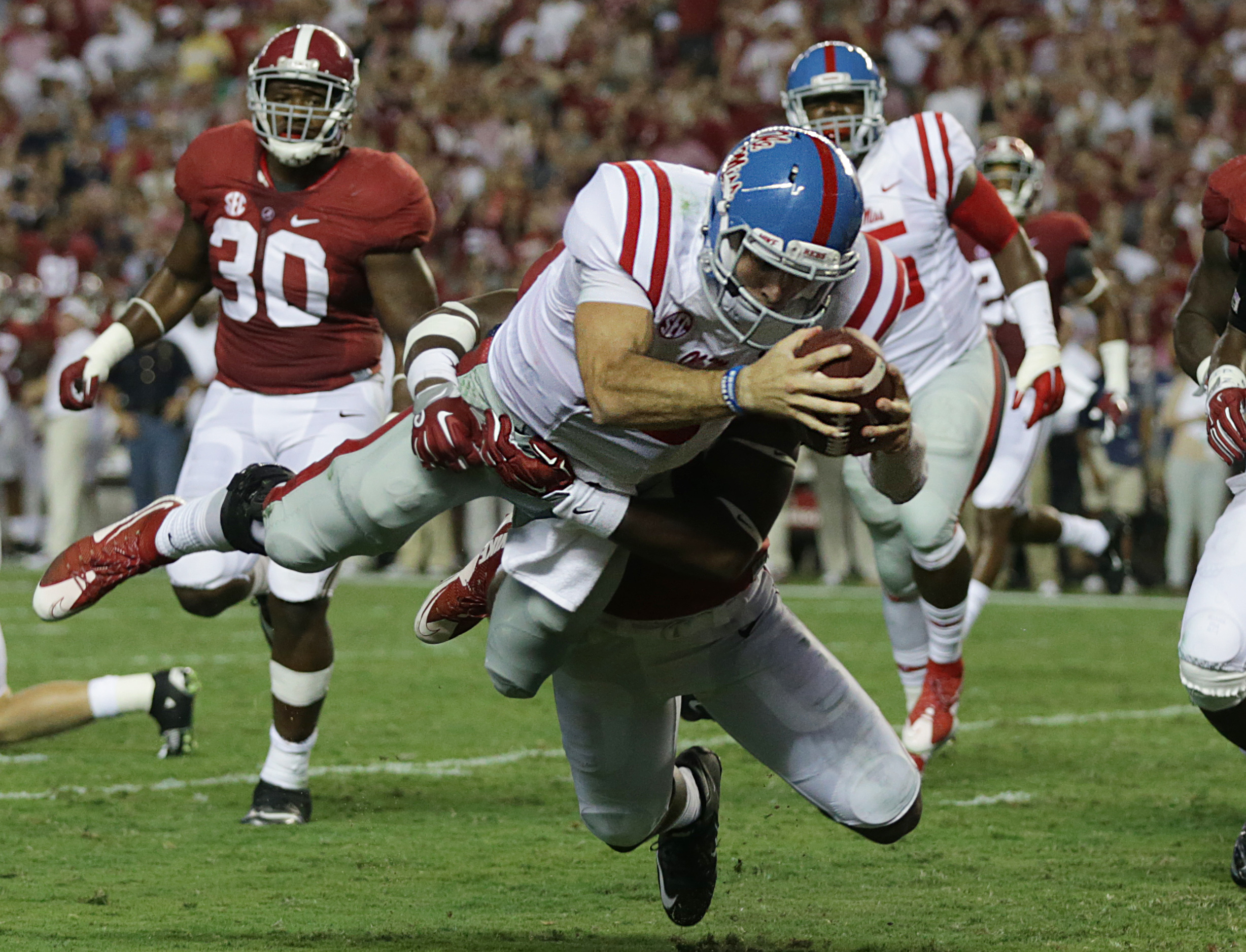FILE - In this Sept. 19, 2015, file photo, Mississippi quarterback Chad Kelly dives in for a touchdown past Alabama linebacker Shaun Hamilton during first half of an NCAA college football game in Tuscaloosa, Ala.  After leading East Mississippi Community