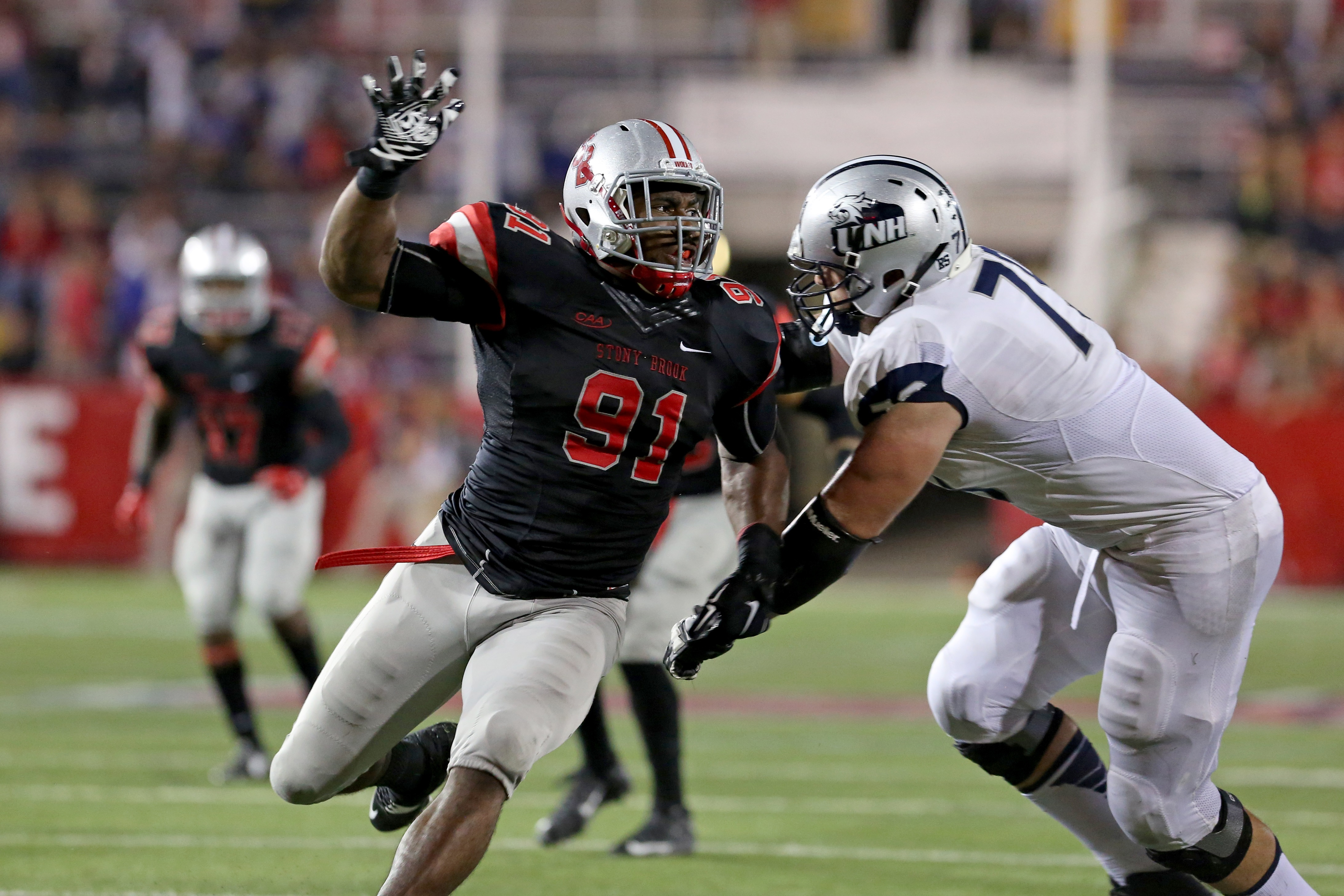 Stony Brook Seawolves Victor Ochi #91 in action against the New Hampshire Wildcats during a college football game on Saturday, September 19, 2015 in Stony Brook, NY.  (AP Photo/Gregory Payan)