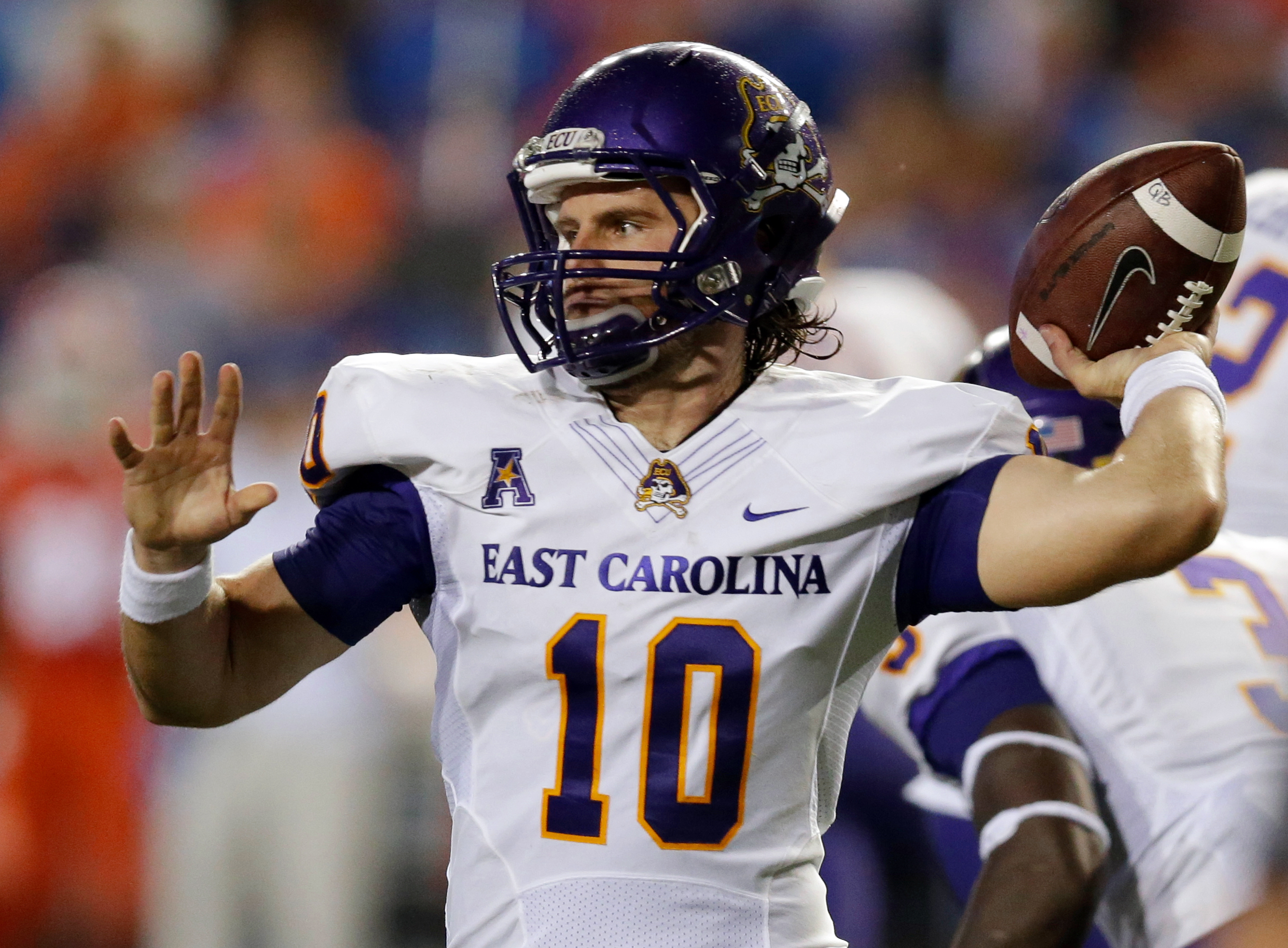 FILE - In this Sept. 12, 2015, file photo, East Carolina quarterback Blake Kemp throws a pass against Florida during the first half of an NCAA college football game in Gainesville, Fla. Kemp has thrown for nearly 900 yards in his first three starts for th