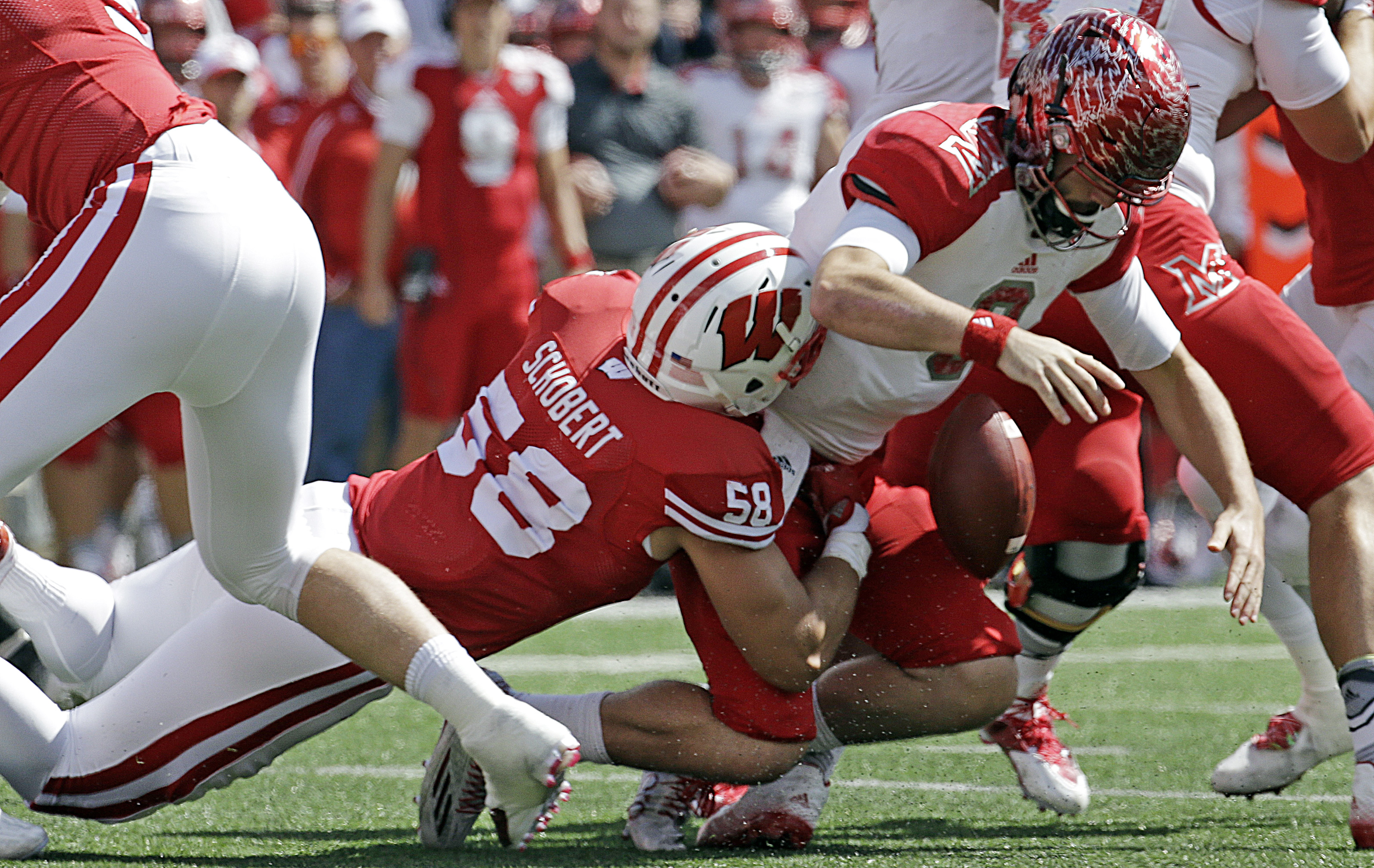 FILE - In this Sept. 12, 2015, file photo, Miami of Ohio quarterback Drew Kummer fumbles the ball as he is sacked by Wisconsin's Joe Schobert (58) during the second half of an NCAA college football game in Madison, Wis. Vince Biegel is high energy. Joe Sc