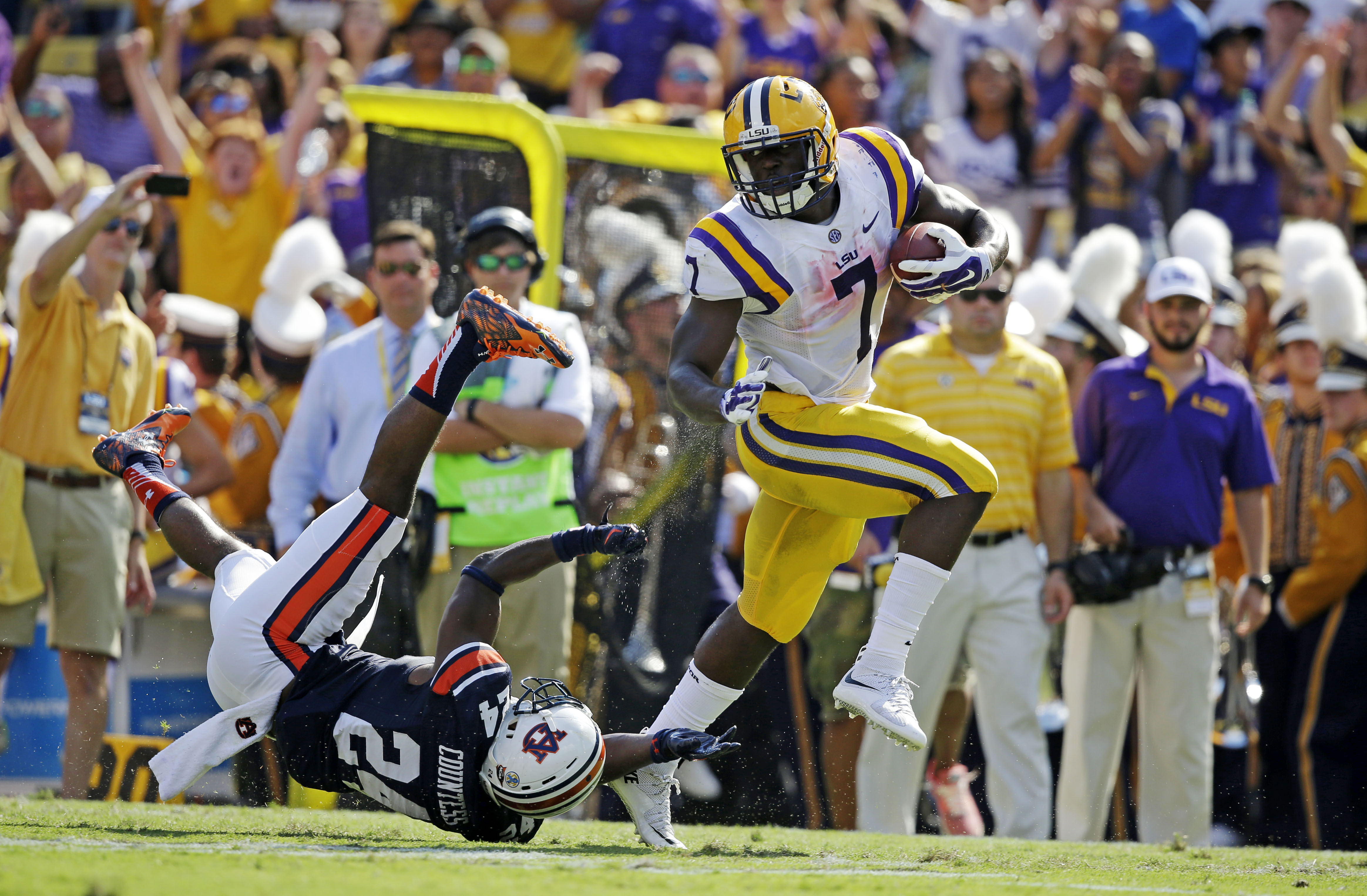 FILE - In this Sept. 19, 2015, file photo, LSU running back Leonard Fournette (7) gets away from Auburn defensive back Blake Countess (24) on a 40-yard touchdown run durin an NCAA college football game in Baton Rouge, La. No. 8 LSU is heading North to tak