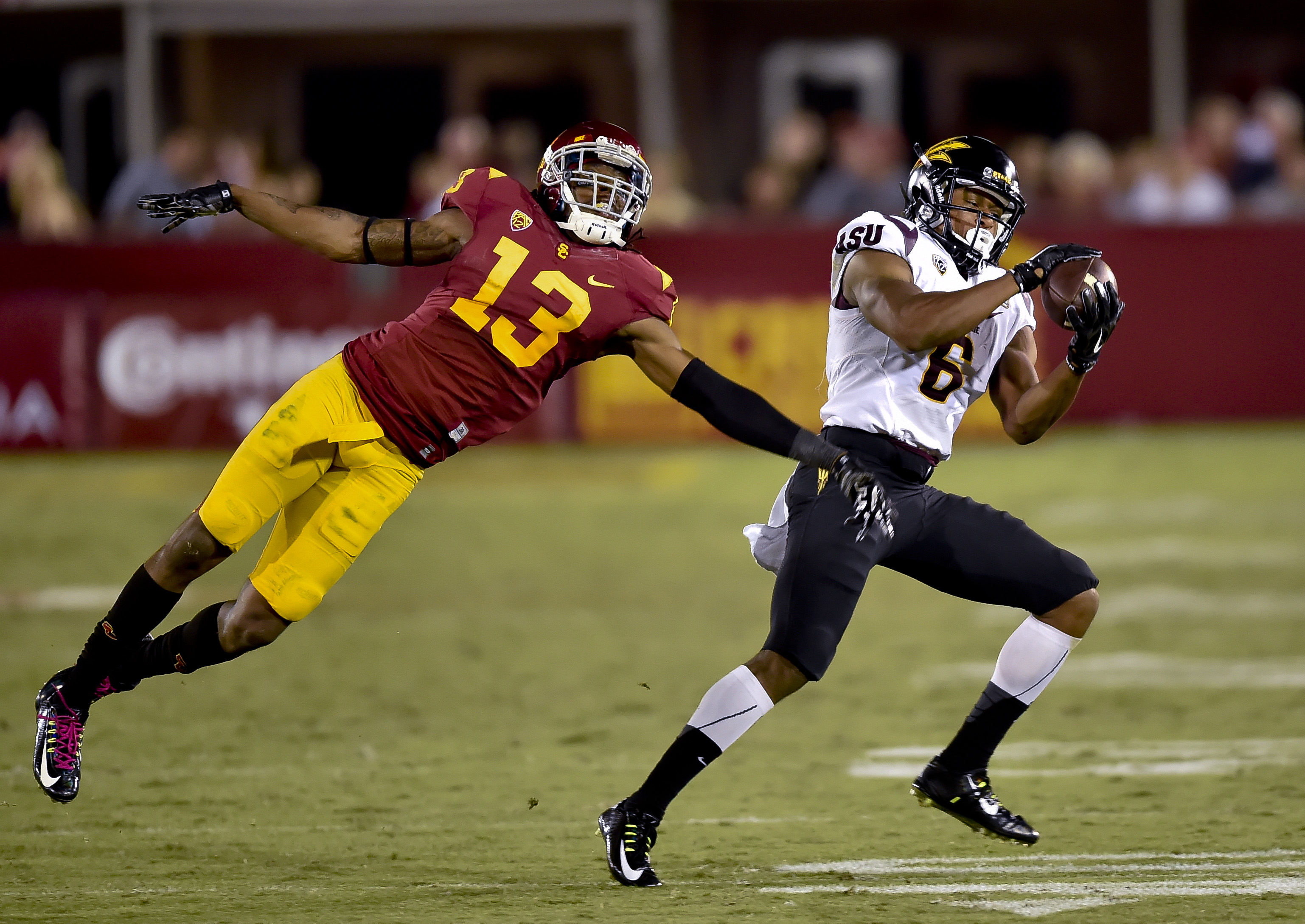 FILE - In this Oct. 4, 2014, file photo, Arizona State wide receiver Cameron Smith (6) gets by Southern California cornerback Kevon Seymour (13) on a touchdown reception during an NCAA college football game in Los Angeles. Arizona State has won two straig