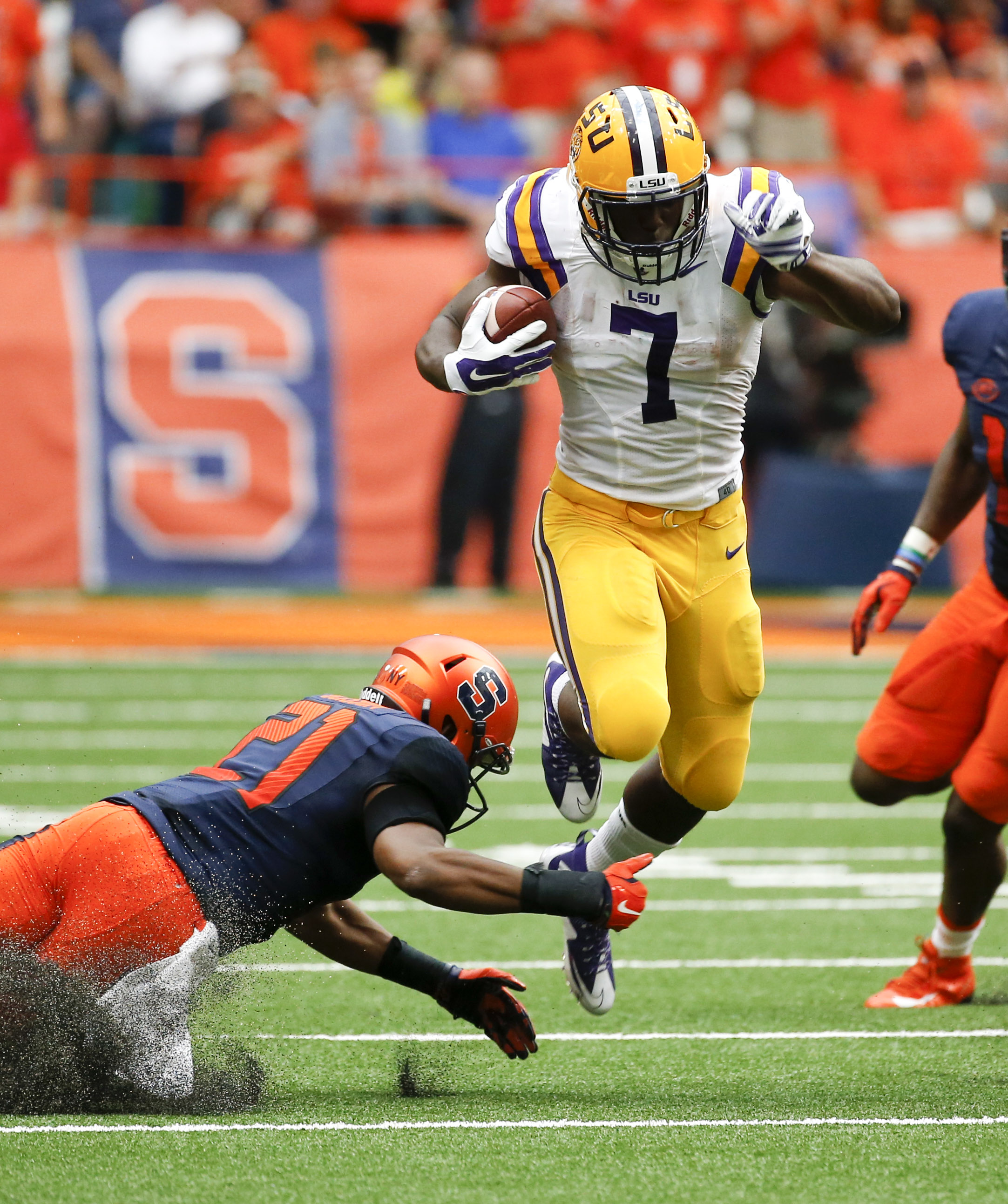 LSU running back Leonard Fournette (7) gets past Syracuse safety Chauncey Scissum (21) during the first half of an NCAA college football game on Saturday, Sept. 26, 2015, in Syracuse, N.Y. (AP Photo/Mike Groll)