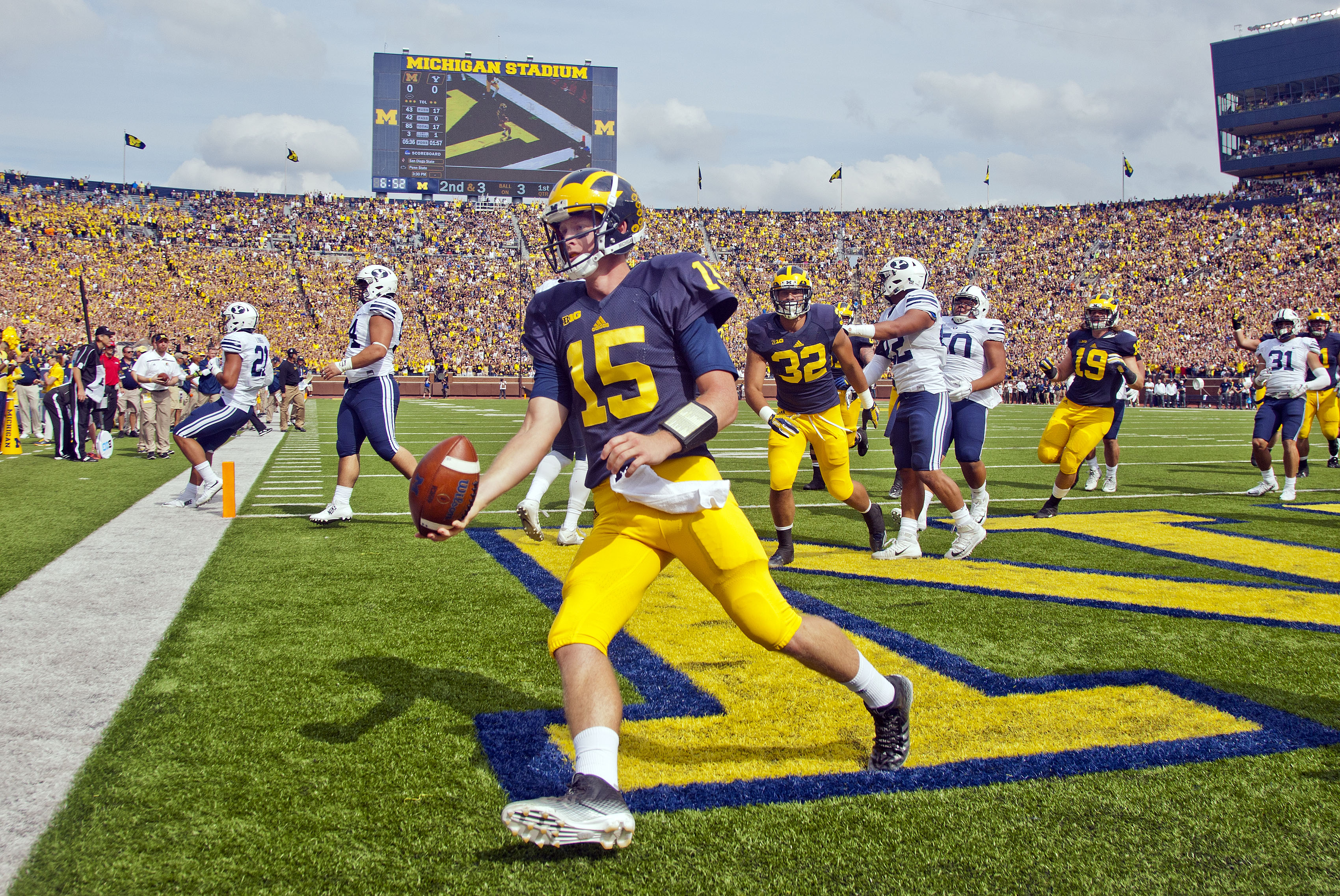 Michigan quarterback Jake Rudock (15) celebrates his touchdown in the first quarter of an NCAA college football game against BYU in Ann Arbor, Mich., Saturday, Sept. 26, 2015. (AP Photo/Tony Ding)
