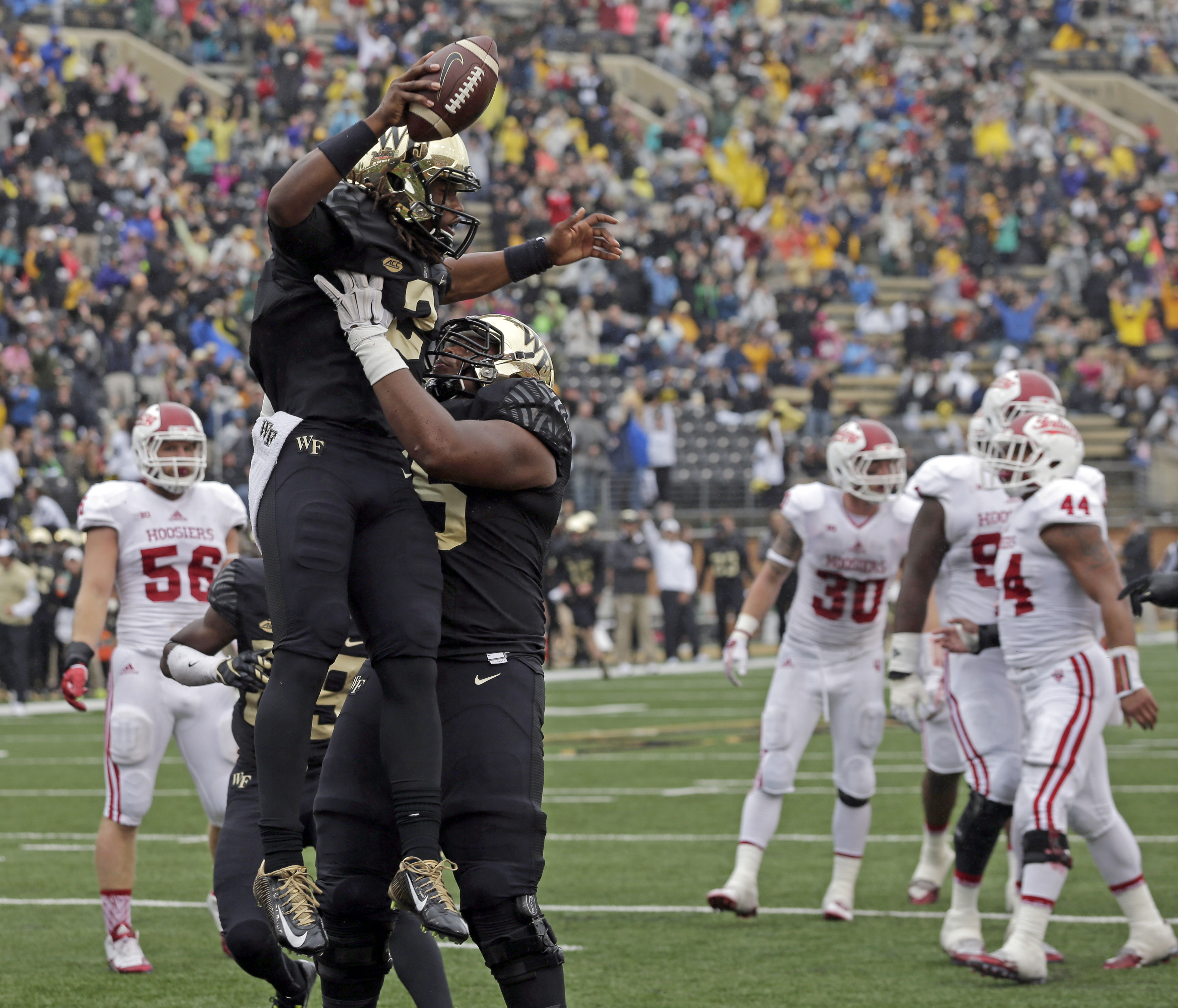 Wake Forest's Kendall Hinton (2) celebrates his touchdown against Indiana with a teammate during the first half of an NCAA college football game in Winston-Salem, N.C., Saturday, Sept. 26, 2015 . (AP Photo/Chuck Burton)