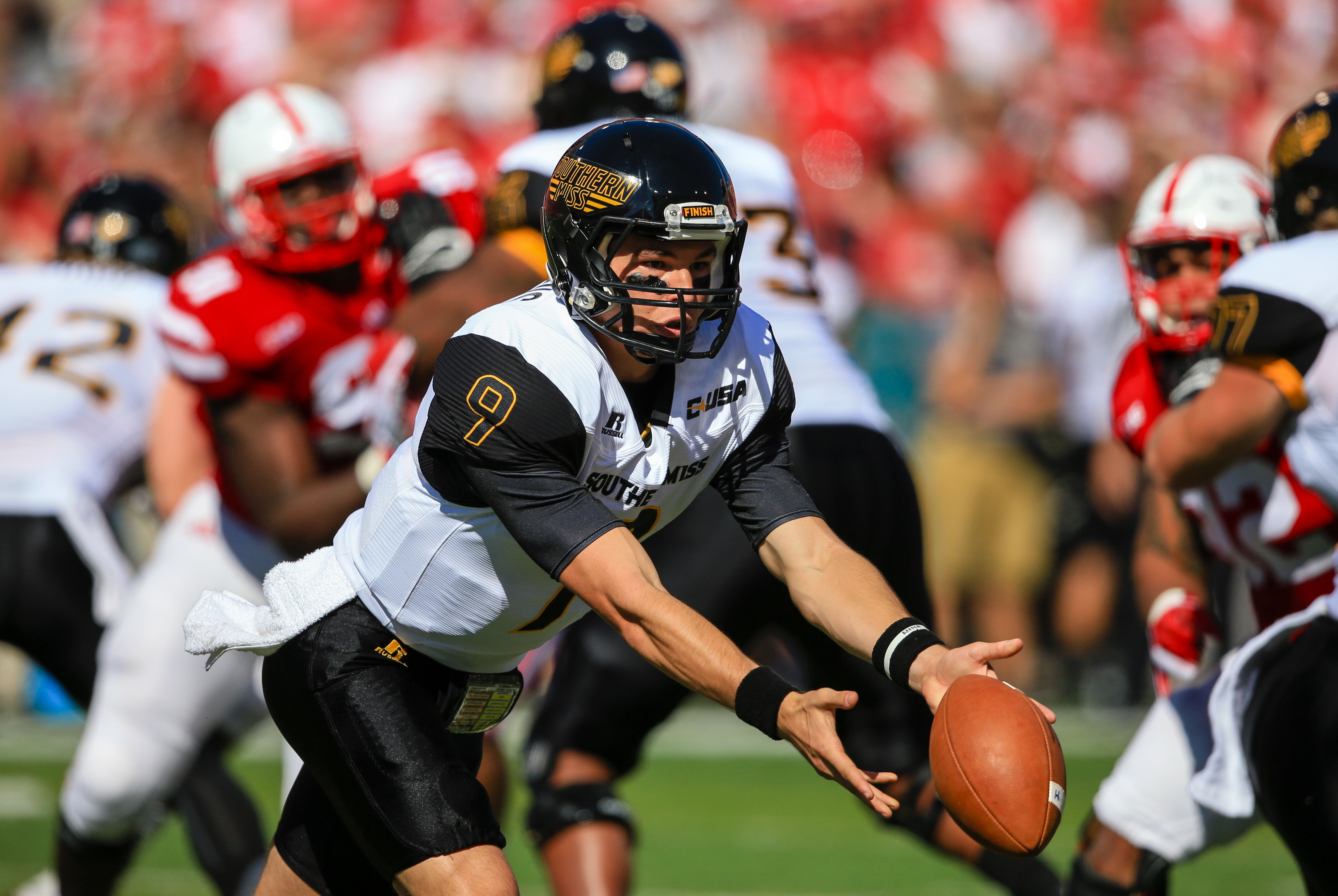 Southern Miss quarterback Nick Mullens (9) hands off the ball during the first half of an NCAA college football game against Nebraska in Lincoln, Neb., Saturday, Sept. 26, 2015. (AP Photo/Nati Harnik)