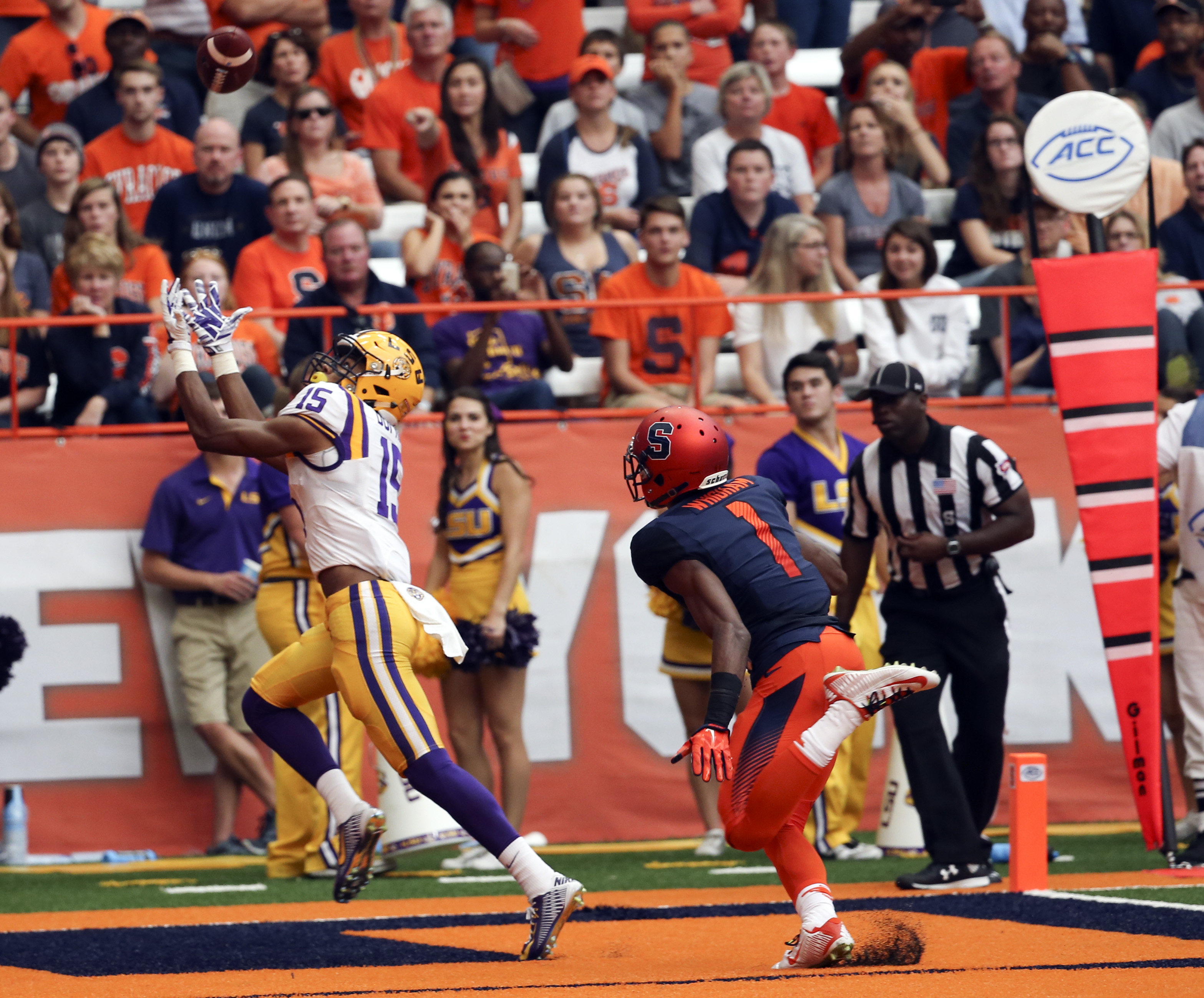 LSU wide receiver Malachi Dupre (15) makes a touchdown reception in front of Syracuse cornerback Julian Whigham (1) during the second half of an NCAA college football game on Saturday, Sept. 26, 2015, in Syracuse, N.Y. (AP Photo/Mike Groll)