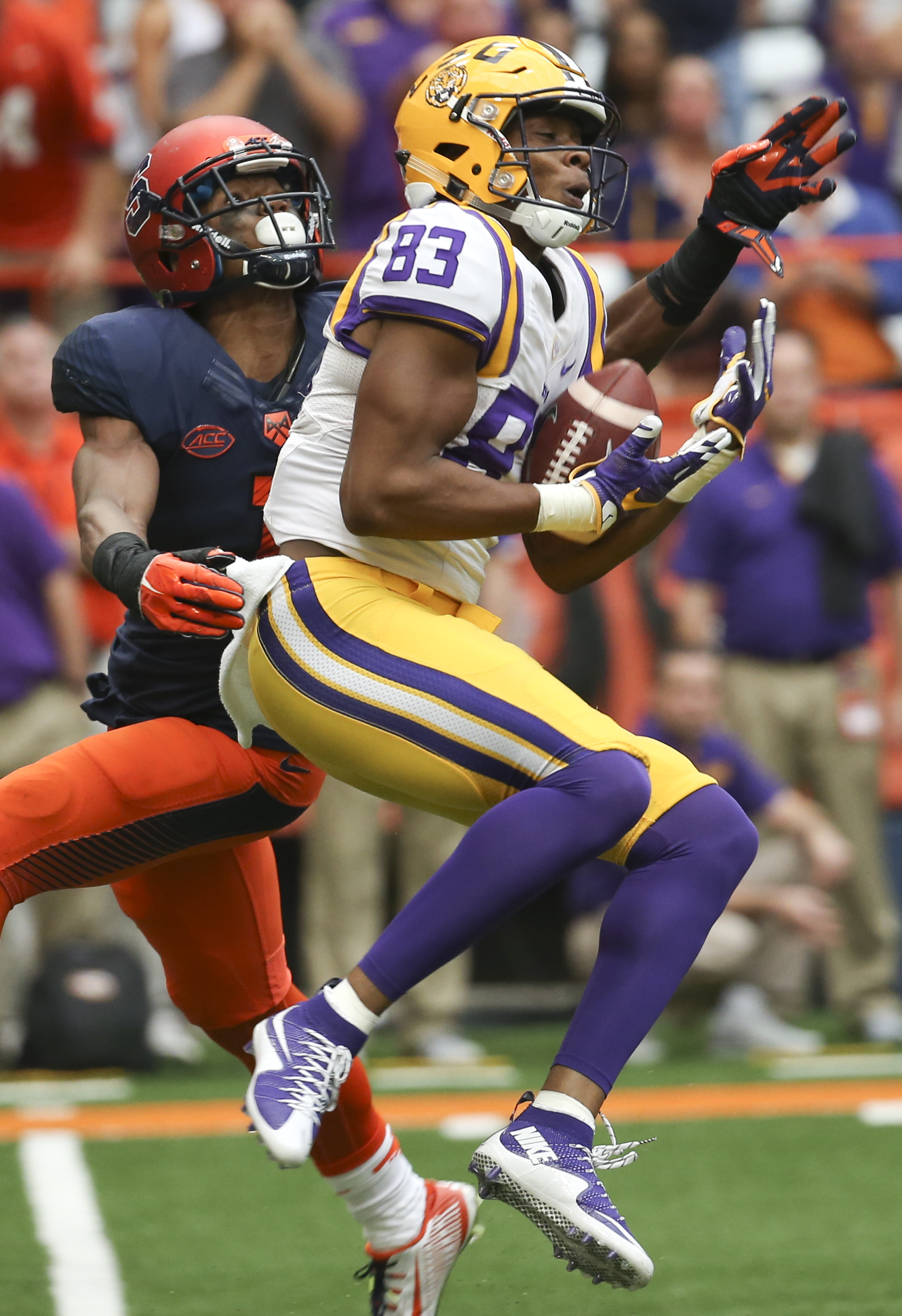 LSU wide receiver Travin Dural (83) makes a catch in front of Syracuse cornerback Julian Whigham (1) during the second half of an NCAA college football game on Saturday, Sept. 26, 2015, in Syracuse, N.Y. (AP Photo/Mike Groll)