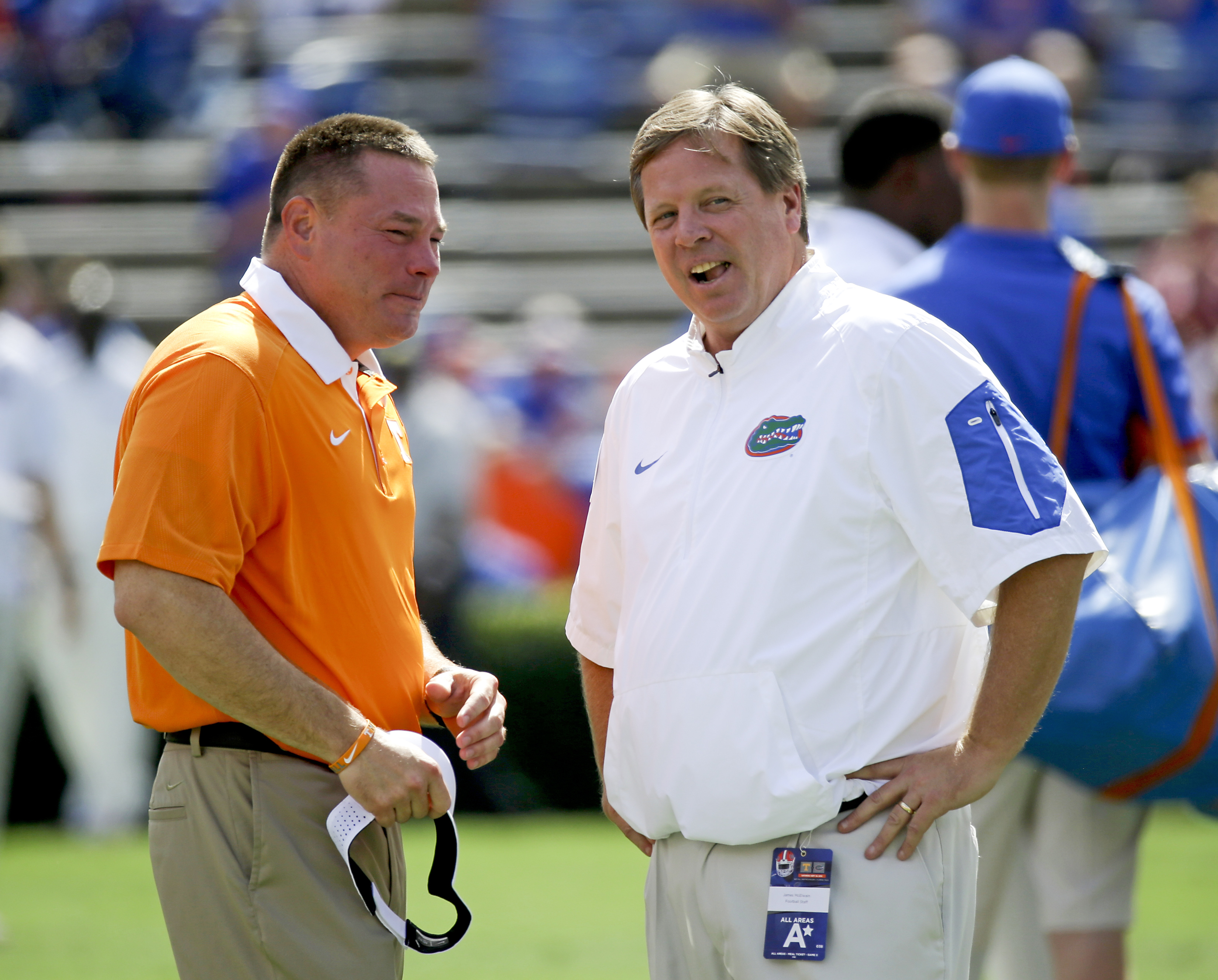 Tennessee head coach Butch Jones, left, and Florida head coach Jim McElwain chat at midfield before an NCAA college football game, Saturday, Sept. 26, 2015, in Gainesville, Fla. (AP Photo/John Raoux)