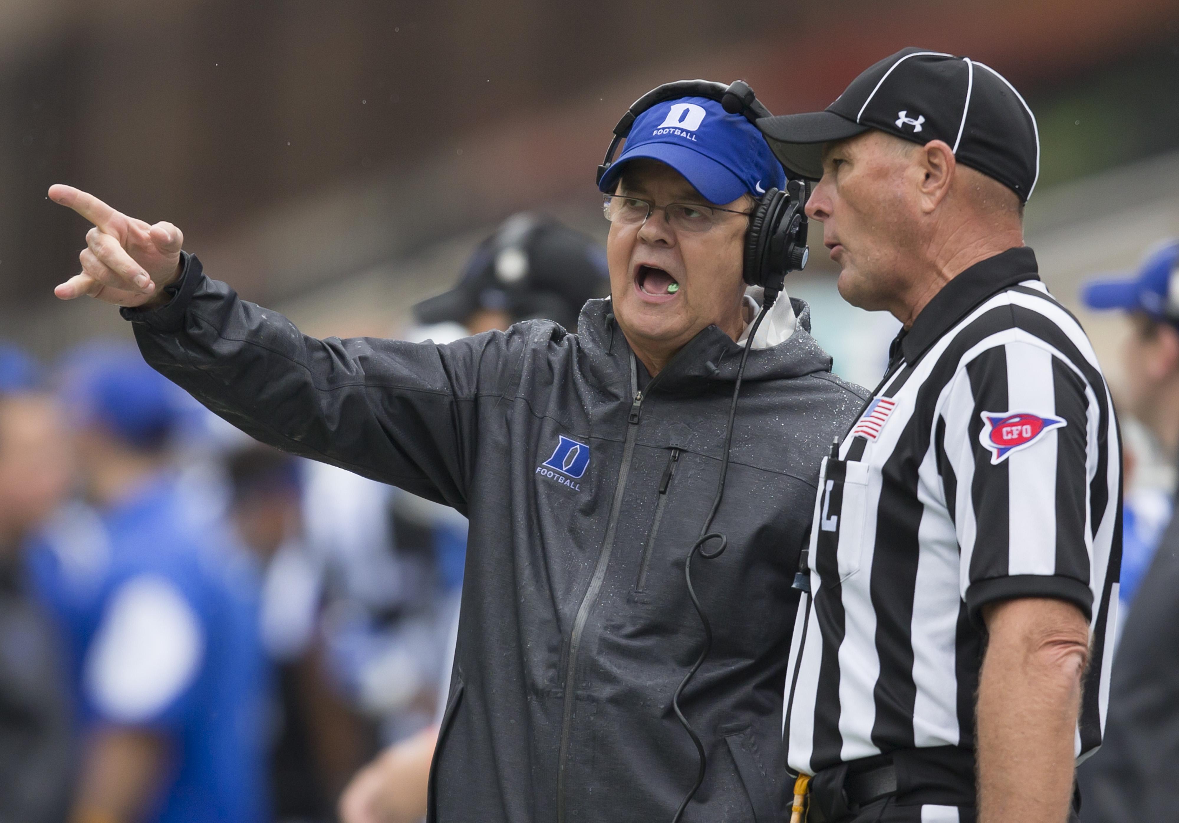 Duke head coach David Cutcliffe, left, talks with a linesman during the second half of an NCAA college football game against Georgia Tech in Durham, N.C., Saturday, Sept. 26, 2015. (AP Photo/Rob Brown)