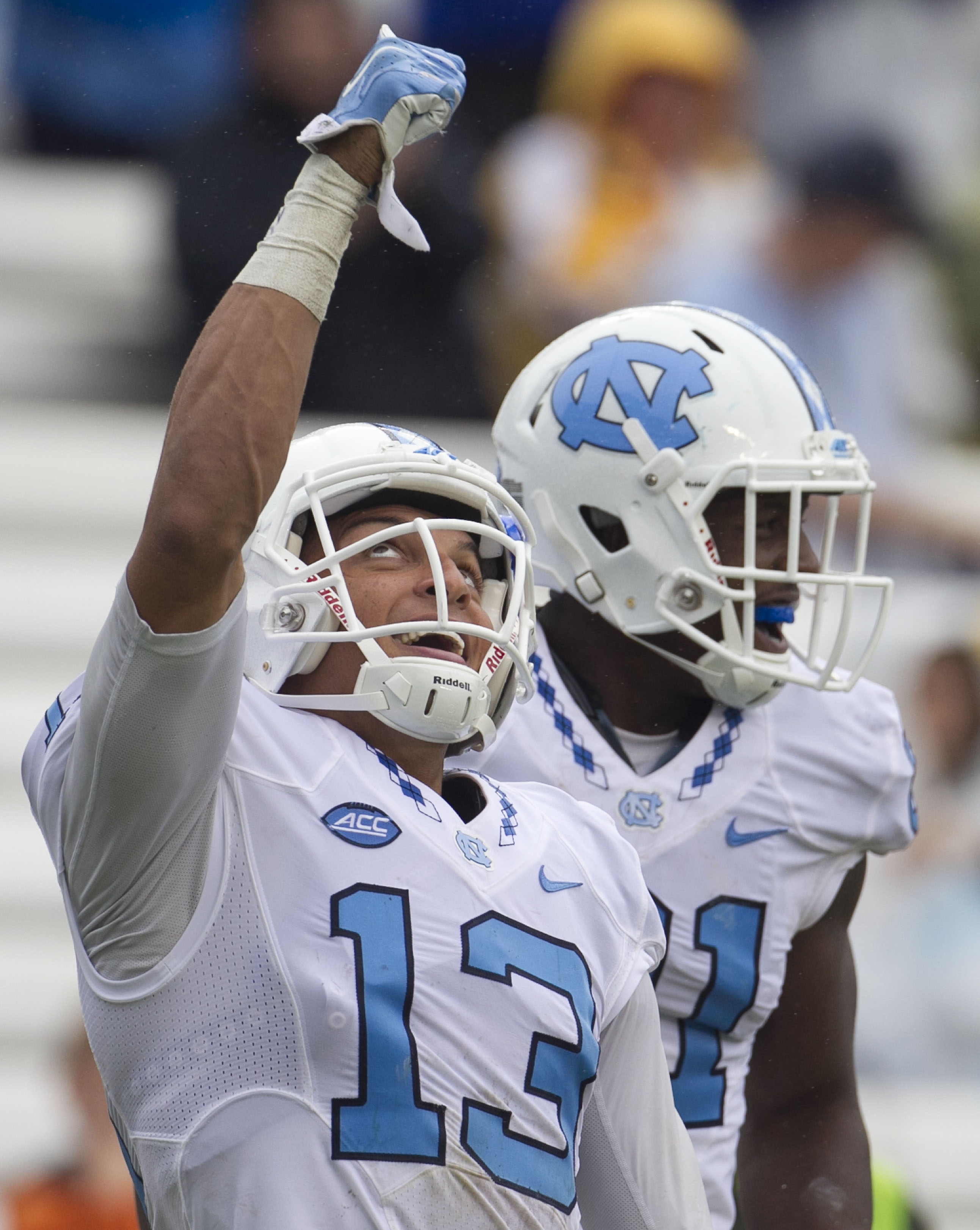 North Carolina's Mack Hollins (13) celebrates his 64 yard touchdown on a pass from quarterback Mitch Trubisky in the third quarter of an NCAA college football game against Delaware on Saturday, Sept. 26, 2015 at Kenan Stadium in Chapel Hill, N.C. (Robert