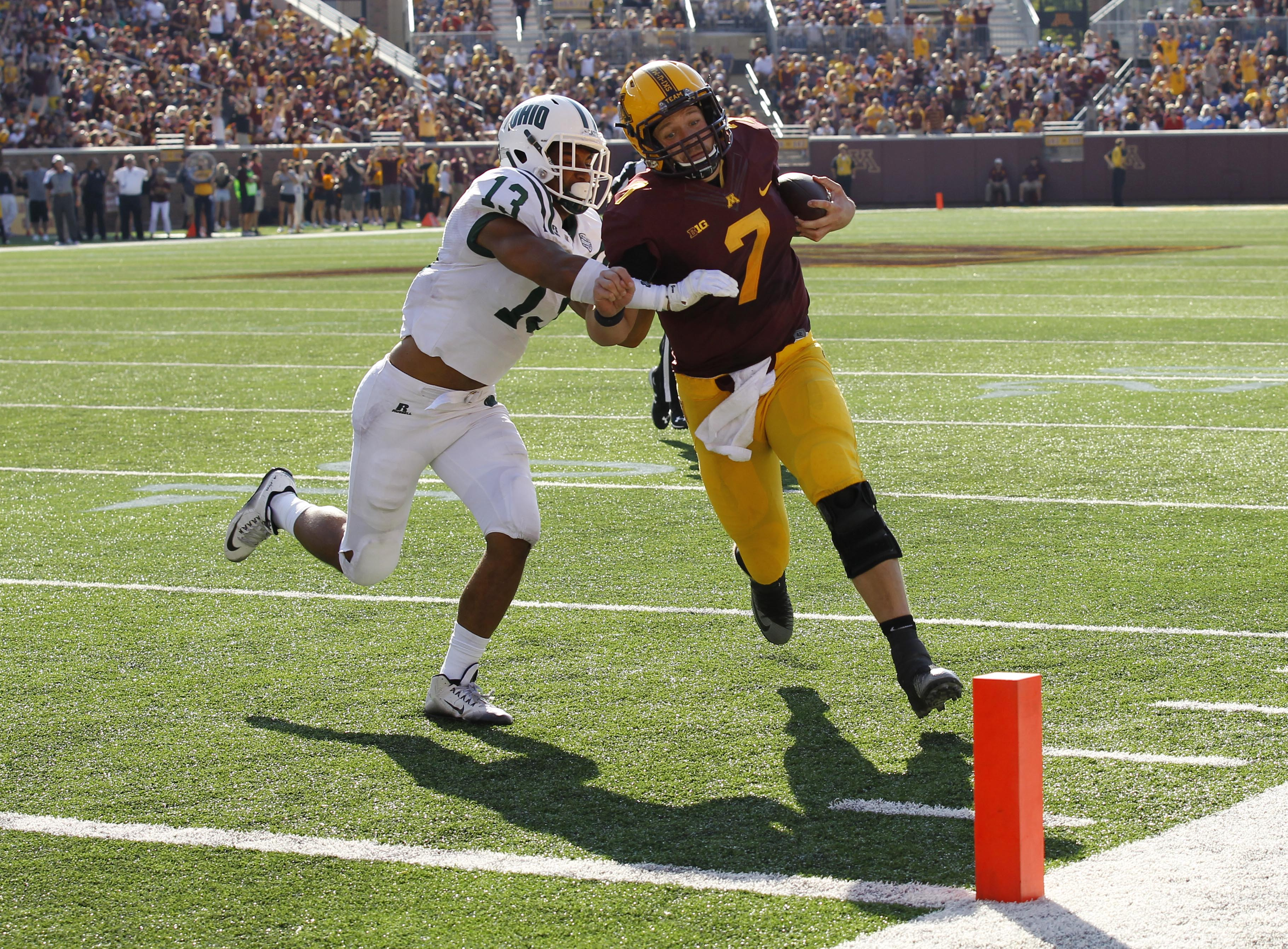 Ohio safety Devin Jones (13) tackles Minnesota quarterback Mitch Leidner (7) during the second quarter of an NCAA college football game in Minneapolis, Saturday, Sept. 26, 2015. (AP Photo/Ann Heisenfelt)