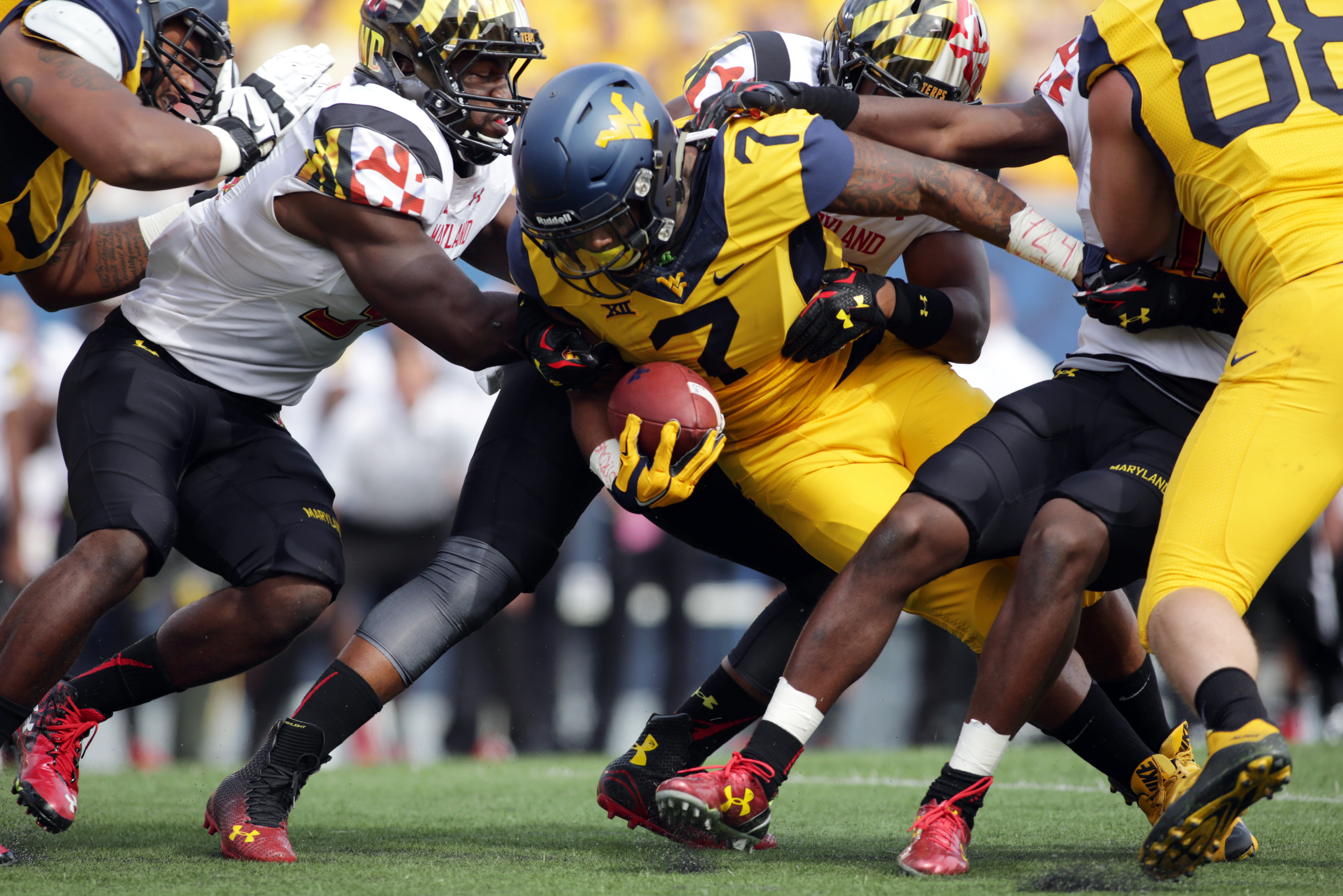 West Virginia running back Rushel Shell (7) is tackled by Maryland linebacker Jefferson Ashiru (34) during the first half of an NCAA college football game, Saturday, Sept. 26, 2015, in Morgantown, W.Va. (AP Photo/Raymond Thompson)