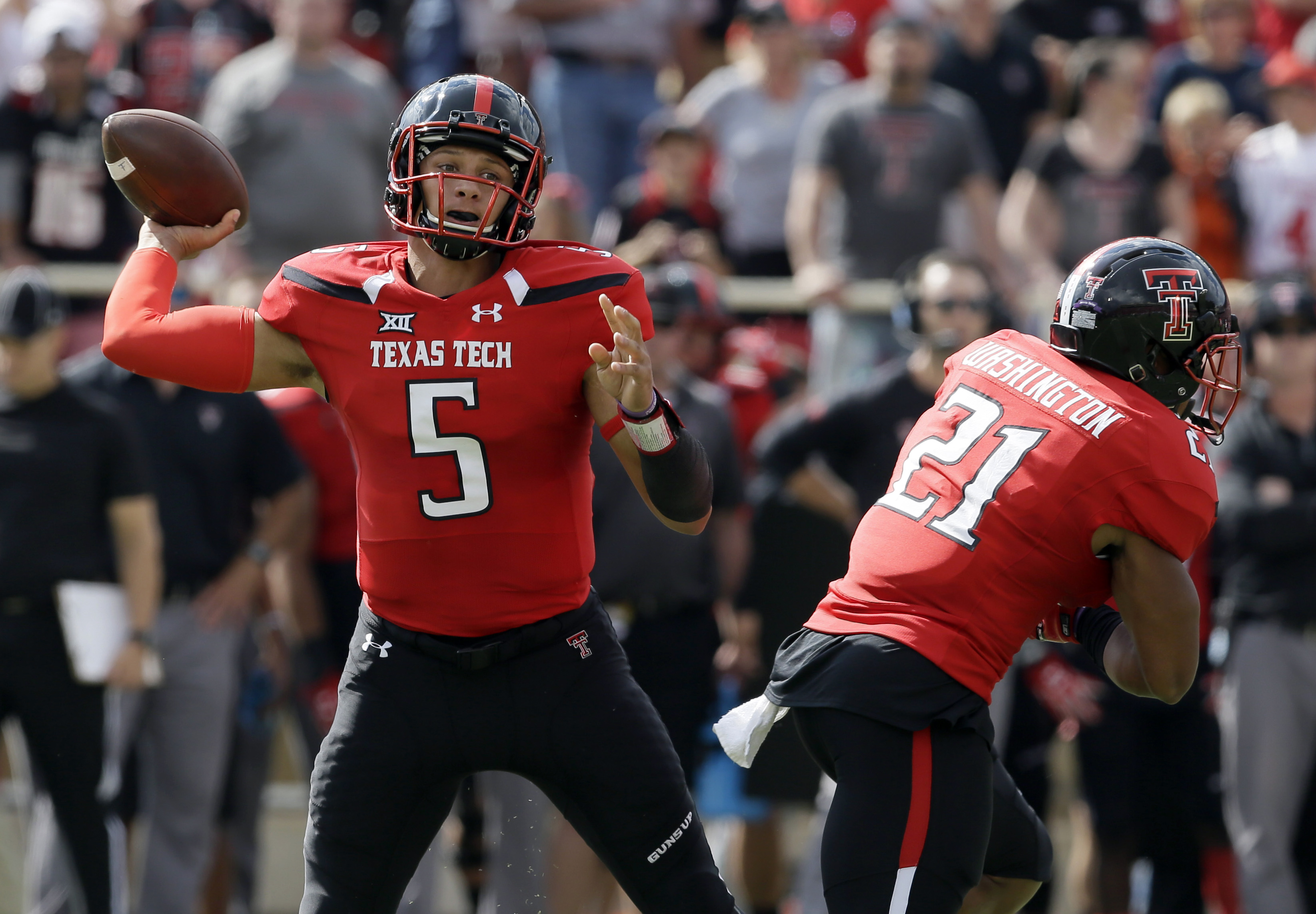 Texas Tech quarterback Patrick Mahomes (5) passes as running back DeAndre Washington (21) runs past during the first half of an NCAA college football game against TCU, Saturday, Sept. 26, 2015, in Lubbock, Texas. (AP Photo/LM Otero)