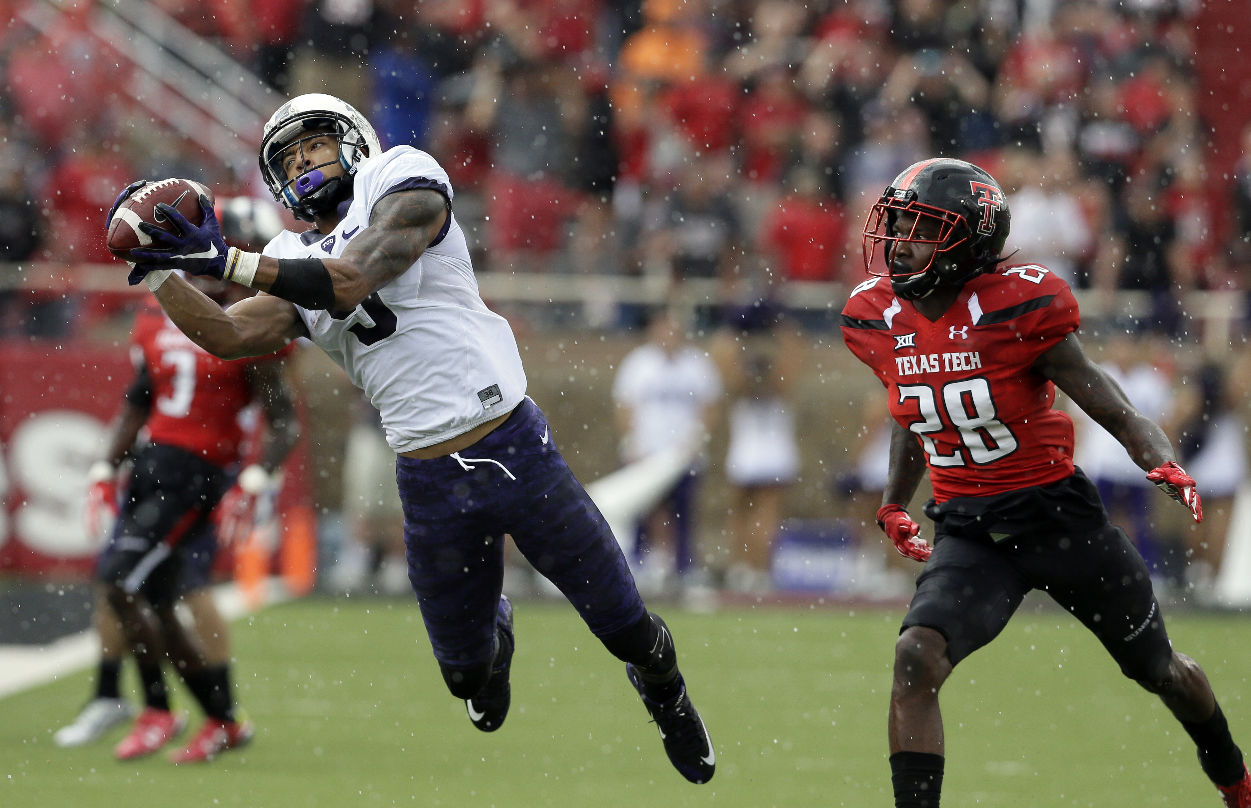 TCU wide receiver Josh Doctson (9) catches a pass in front of Texas Tech defensive back Paul Banks (28) during the first half of an NCAA college football game, Saturday, Sept. 26, 2015, in Lubbock, Texas. (AP Photo/LM Otero)