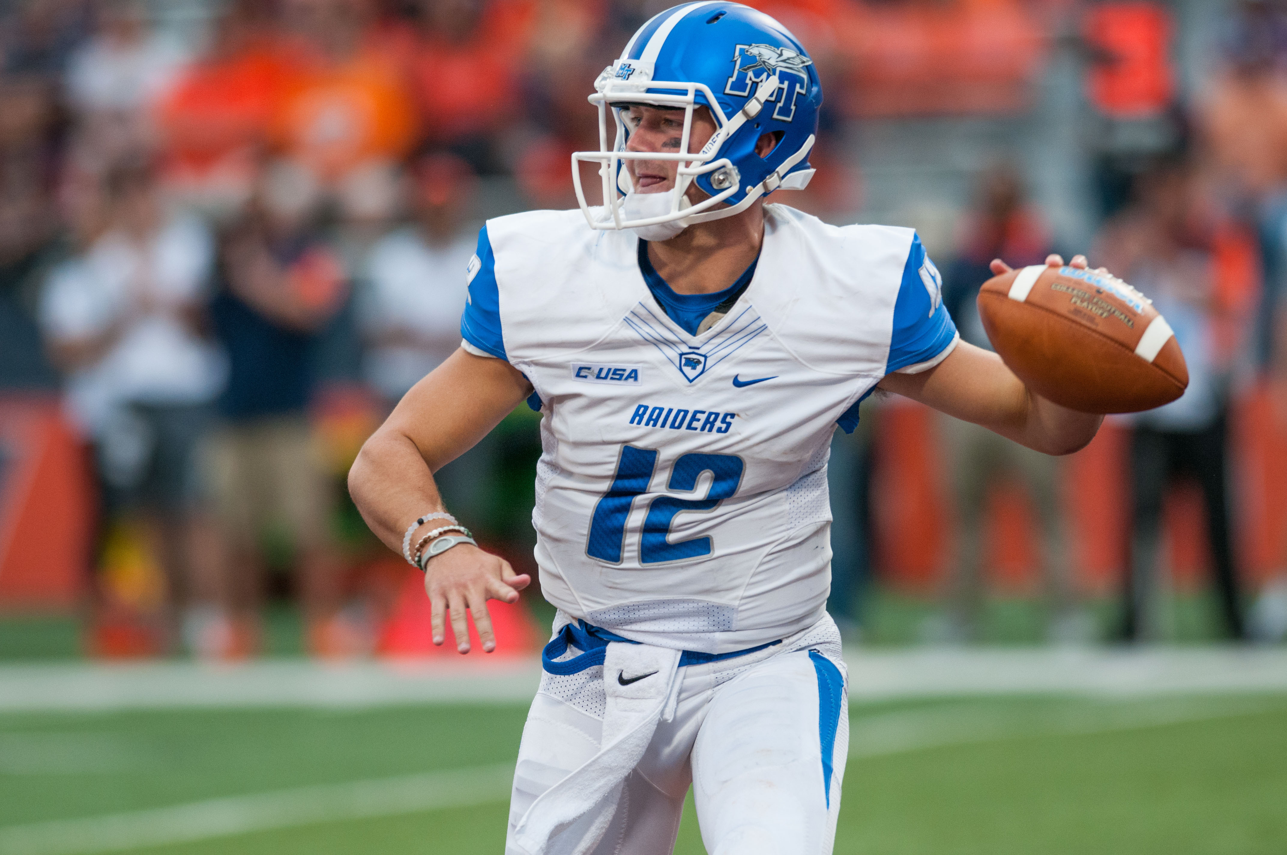 Middle Tennessee quarterback Brent Stockstill (12) throws the ball during the third quarter of an NCAA football game against Illinois Saturday, Sept. 26, 2015 at Memorial Stadium in Champaign, Ill.  Illinois won 27-25. (AP Photo/Bradley Leeb)