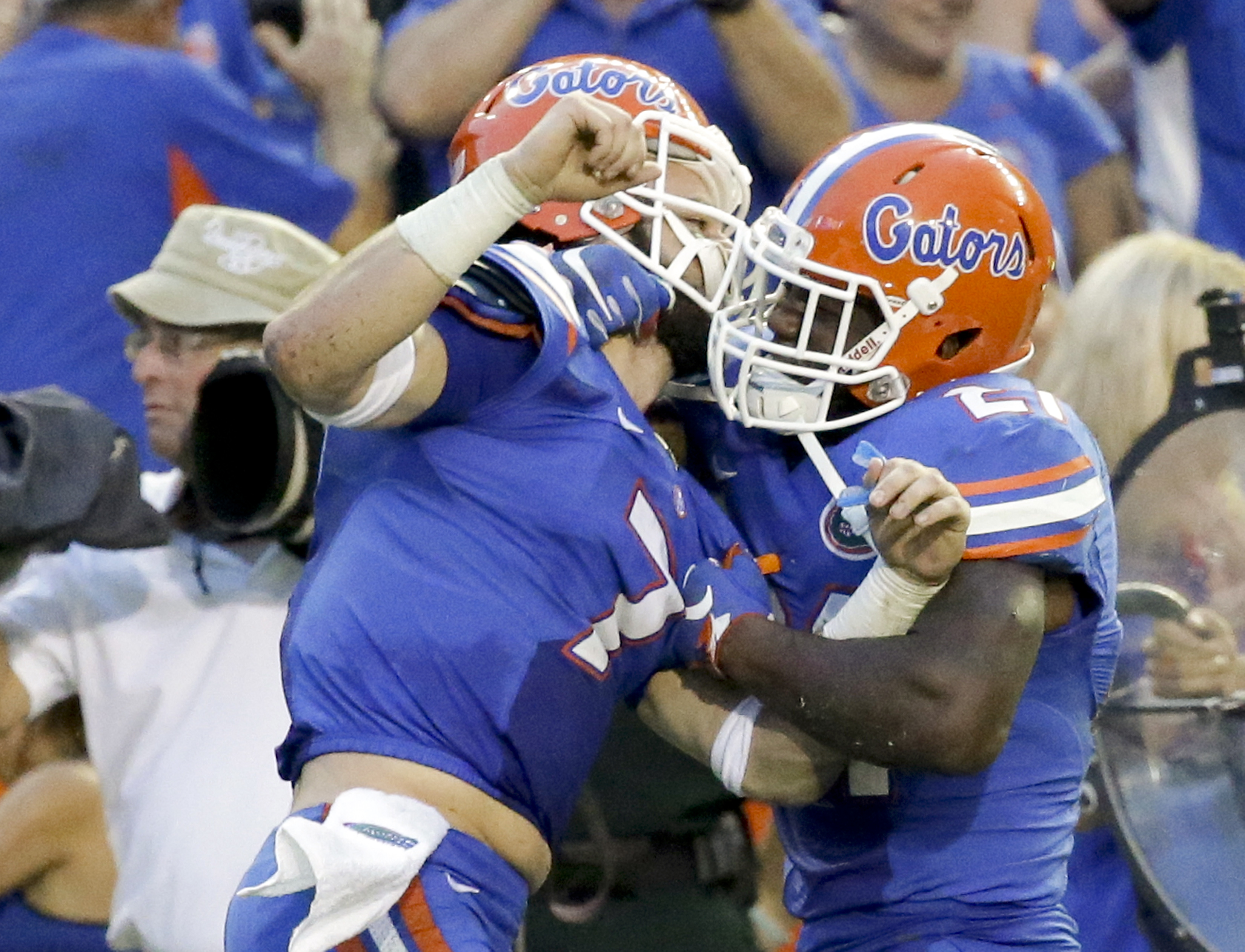 Florida quarterback Will Grier, left, and running back Kelvin Taylor celebrate after Grier threw a 63-yard touchdown pass to wide receiver Antonio Callaway for the winning touchdown against Tennessee during the final minutes of an NCAA college football ga