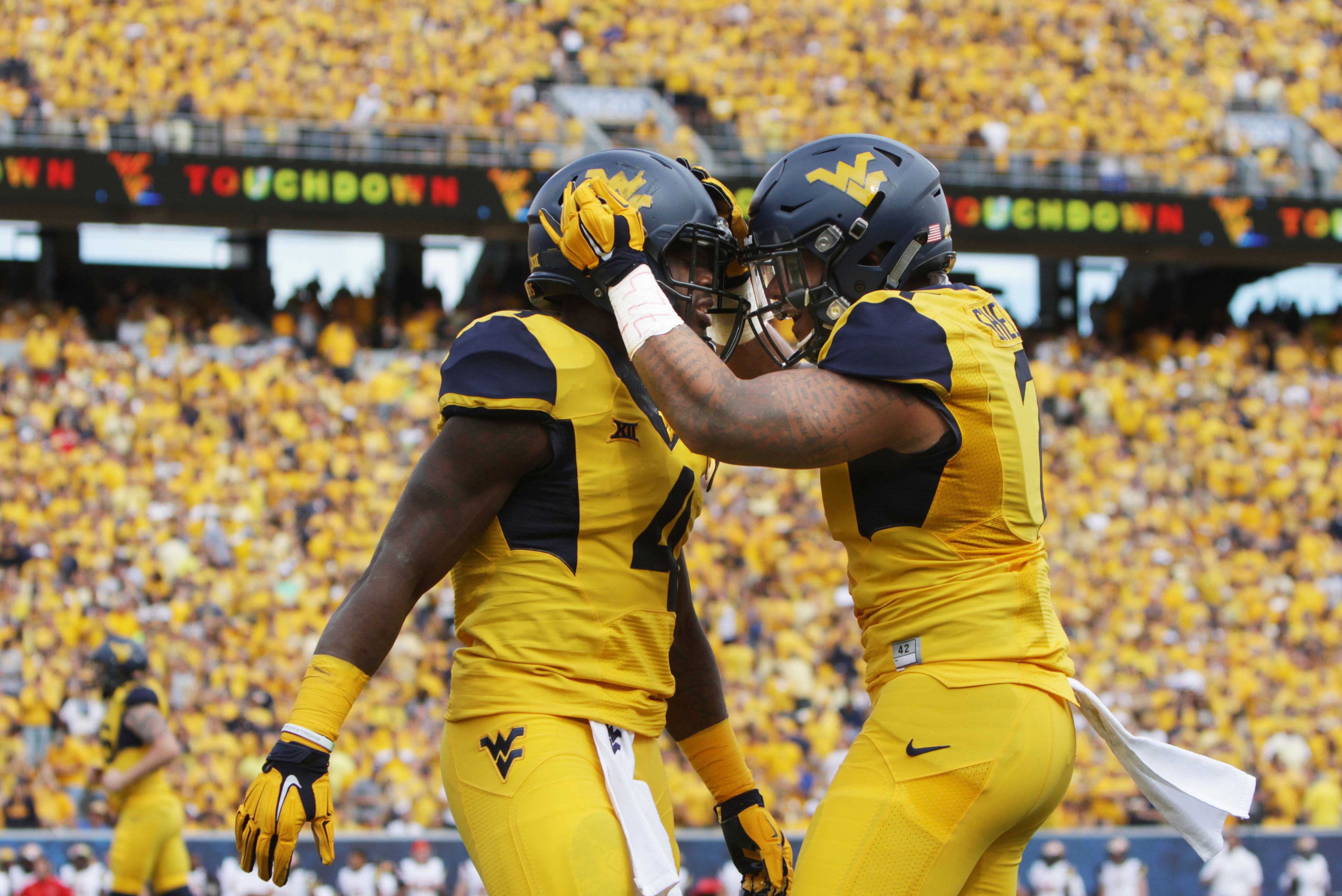 After scoring a touchdown, West Virginia running back Wendell Smallwood (4) celebrates with his teammate West Virginia running back Rushel Shell (7) during the first half of an NCAA college football game against Maryland, Saturday, Sept. 26, 2015, in Morg