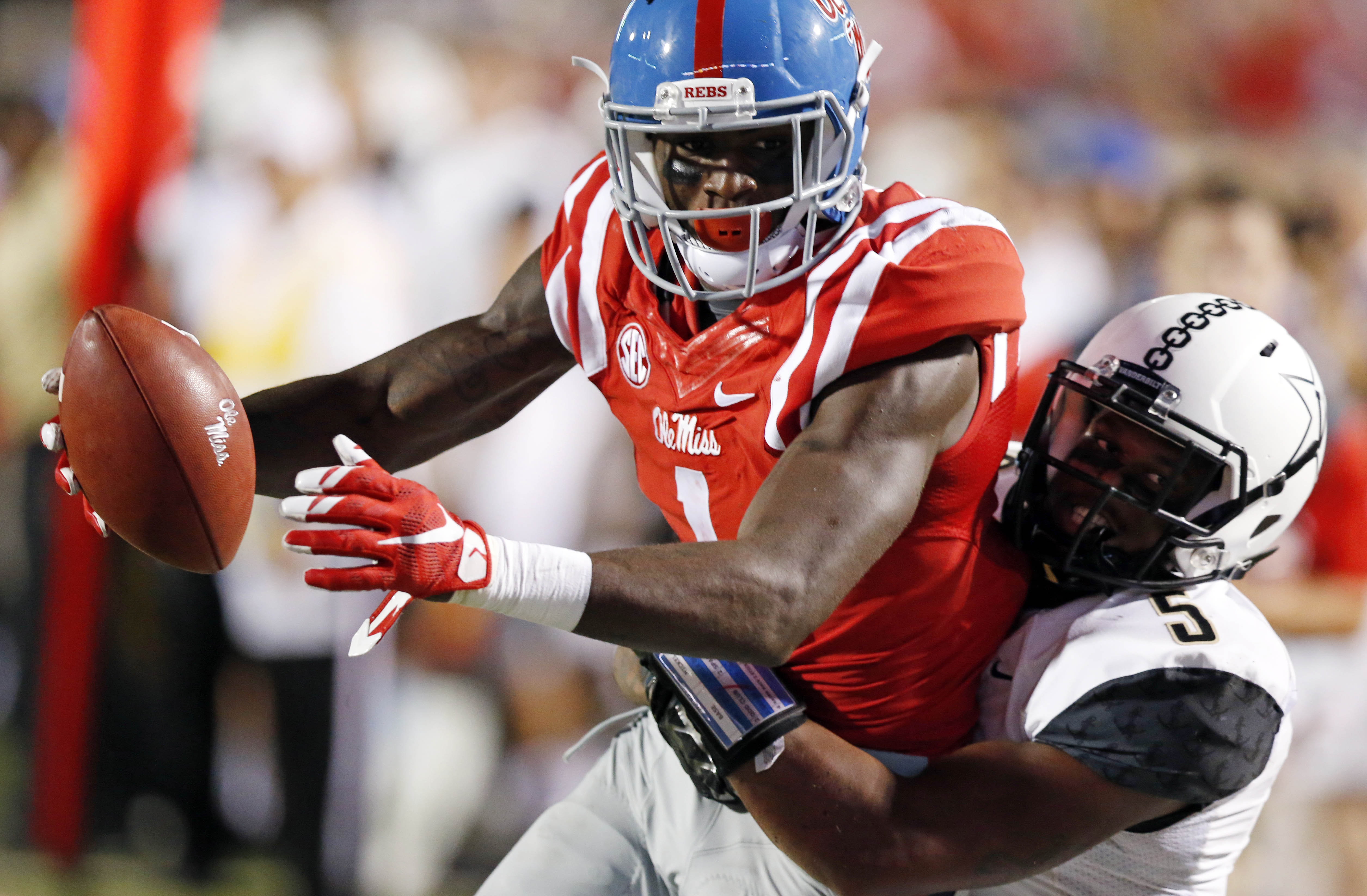 Mississippi wide receiver Laquon Treadwell (1) is tackled short of a touchdown after a pass reception against Vanderbilt cornerback Torren McGaster (5) during the first half of an NCAA college football game Saturday, Sept. 26, 2015, in Oxford, Miss. (AP P