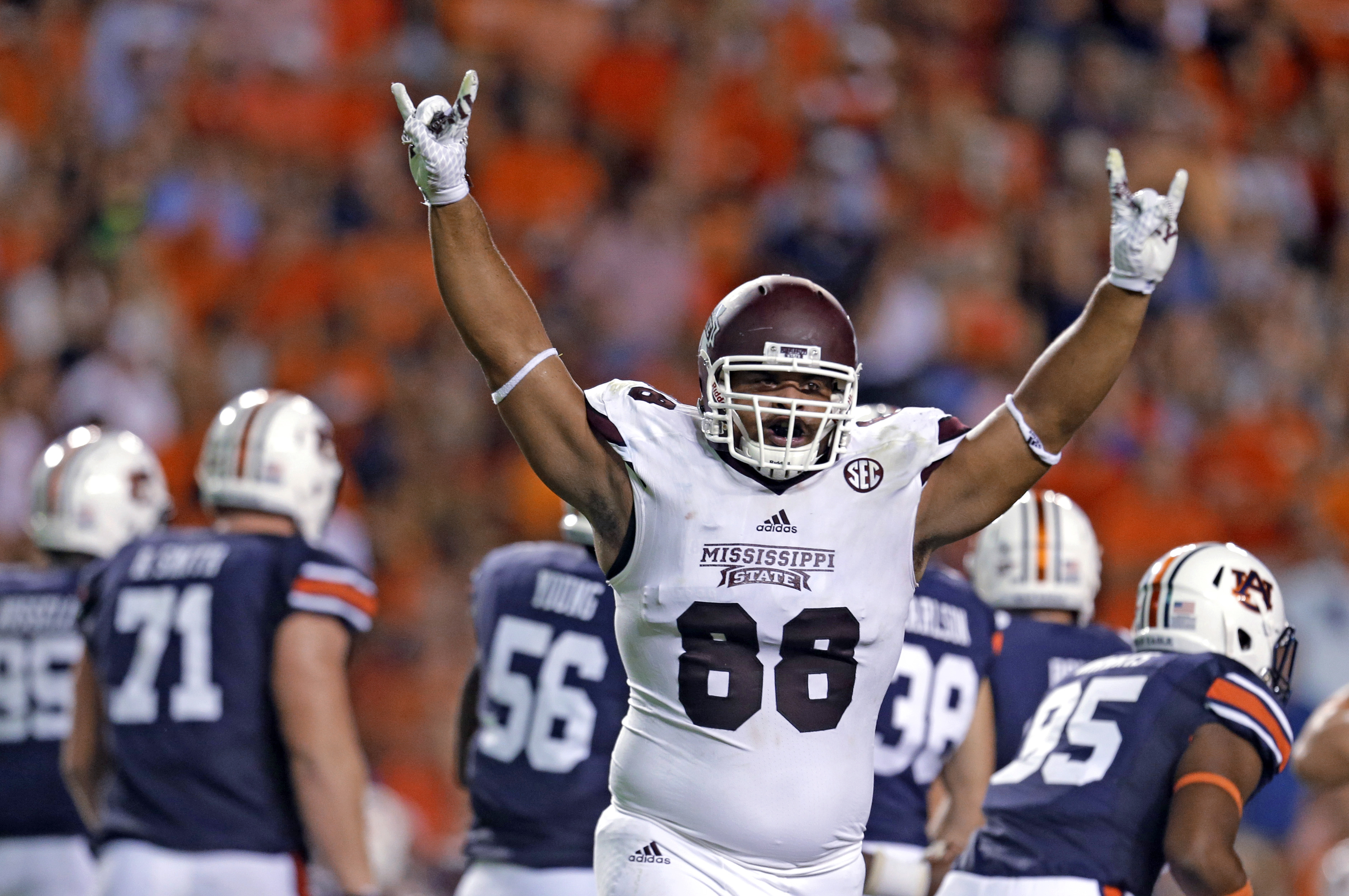 Mississippi State defensive lineman Nick James (88) celebrates after Auburn's Daniel Carlson (38) missed a field goal during the first half of an NCAA college football game, Saturday, Sept. 26, 2015, in Auburn, Ala. (AP Photo/Butch Dill)