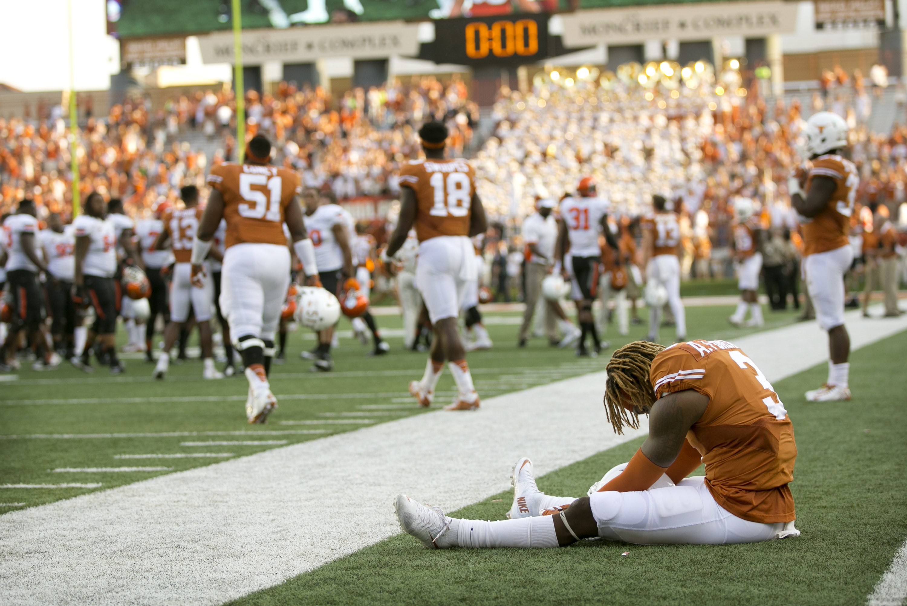 Texas wide receiver Armanti Foreman sits on the field after Oklahoma State's 30-27 win in an NCAA college football game in Austin, Texas, Saturday, Sept. 26, 2015.  (Jay Janner/Austin American-Statesman via AP)