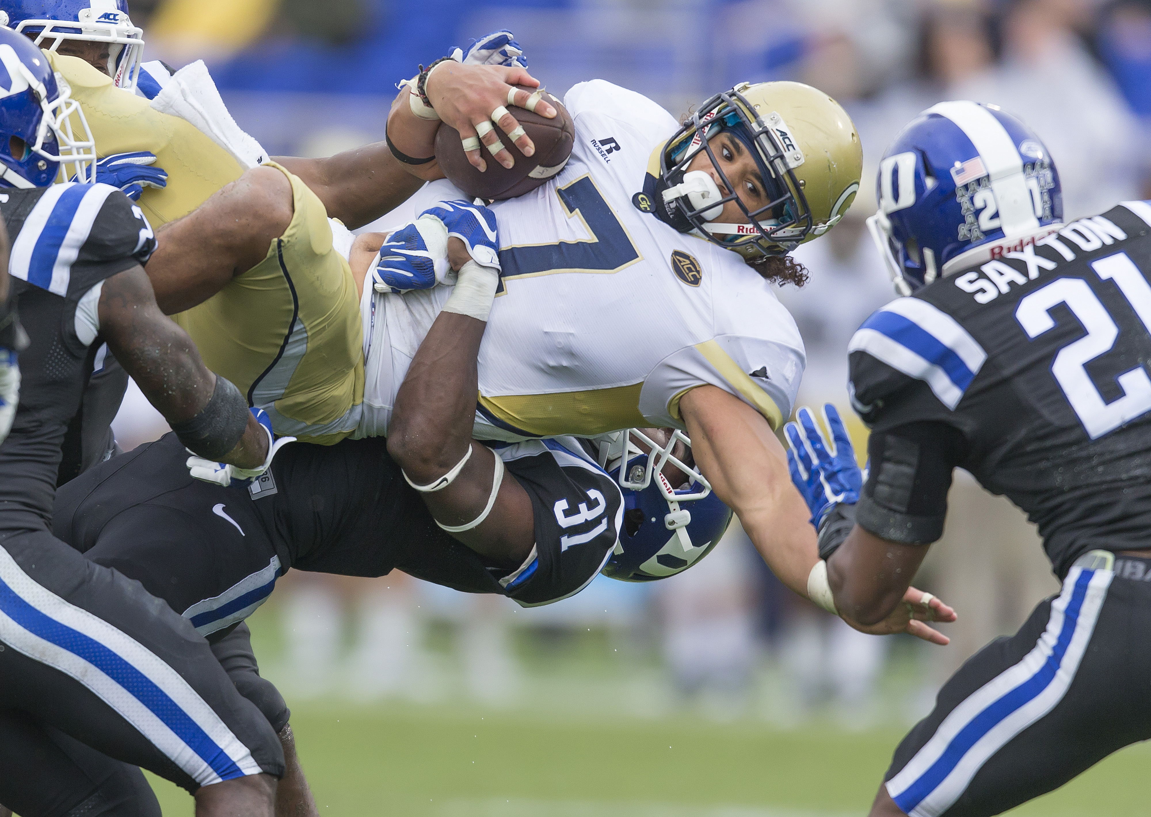 FILE - In this Sept. 26, 2015 file photo, Georgia Tech's Patrick Skov is upended by Duke's Breon Borders after picking up a first down during the second half of an NCAA college football game, in Durham, N.C.  Georgia Tech's usually potent spread-option of