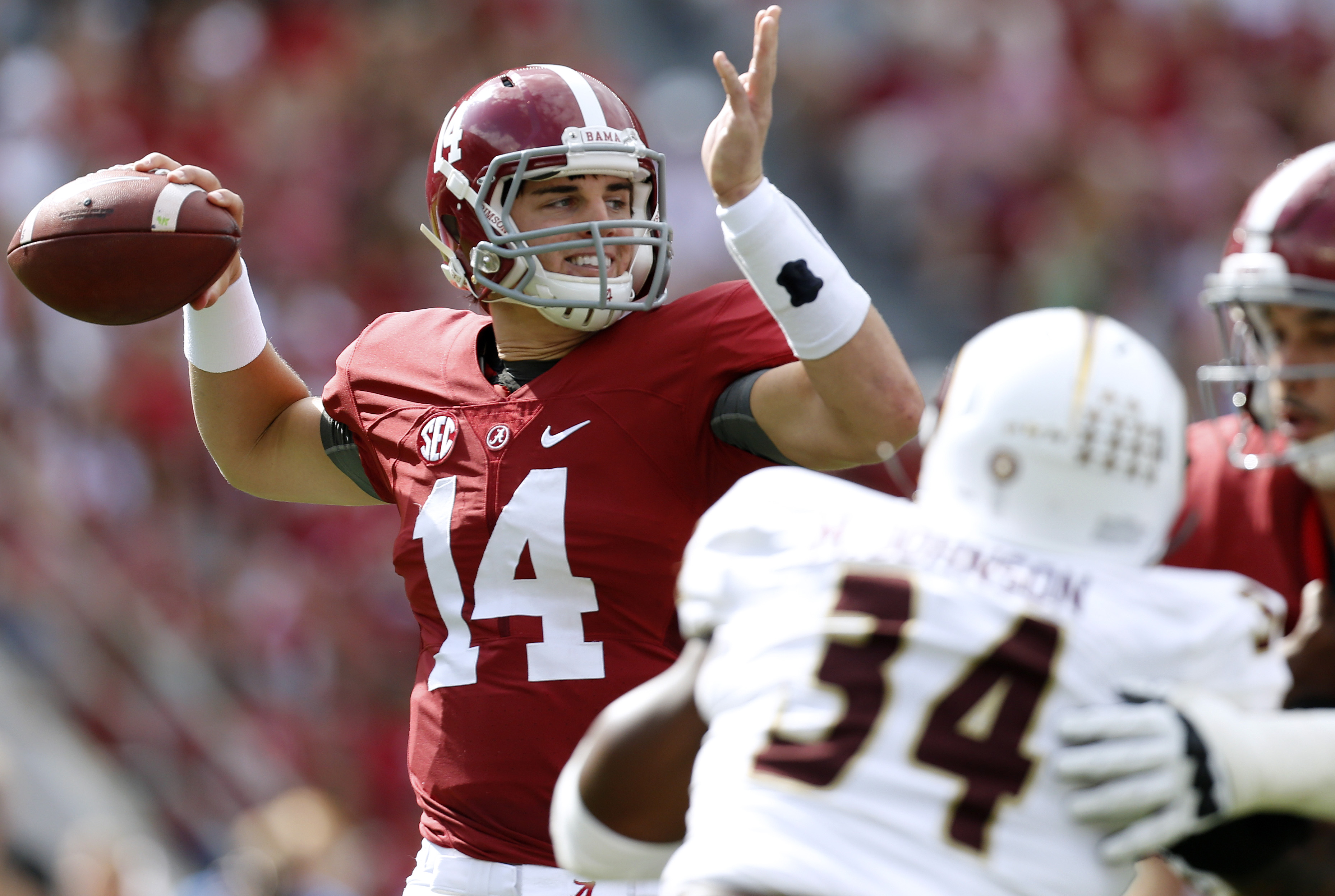 FILE - In this Sept. 26, 2015, file photo, Alabama quarterback Jake Coker (14) throws a pass during the first half of an NCAA college football game against Louisiana Monroe in Tuscaloosa, Ala. In Athens, Georgia, the Bulldogs (4-0, 2-0) host No. 13 Alabam