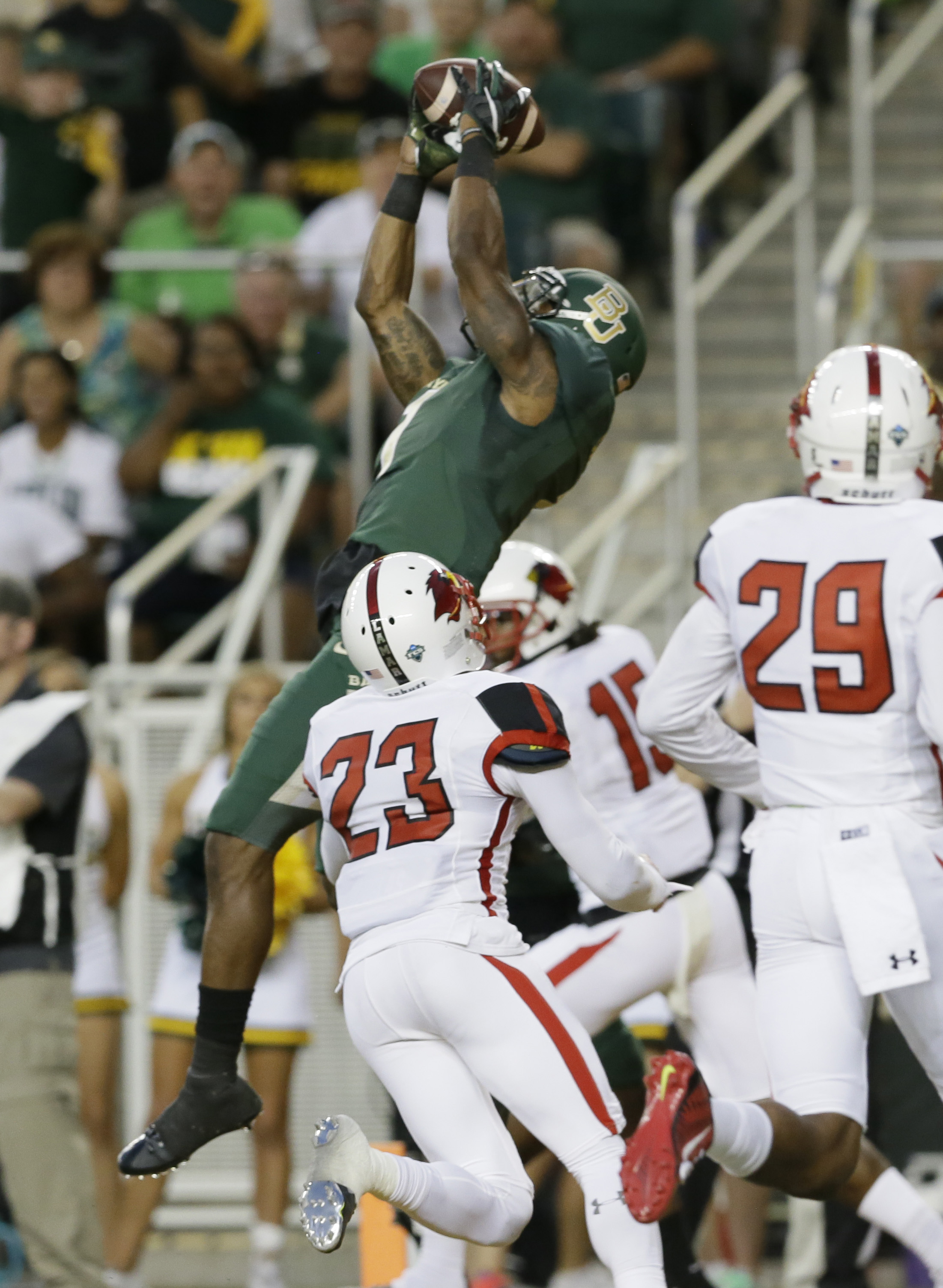 FILE - In this Sept. 12, 2015, file photo, Baylor wide receiver Corey Coleman (1) catches a touchdown pass against Lamar defenders Lloyd Julian (23) and Xavier Bethany (29) during the first half of an NCAA college football game in Waco, Texas. (AP Photo/L