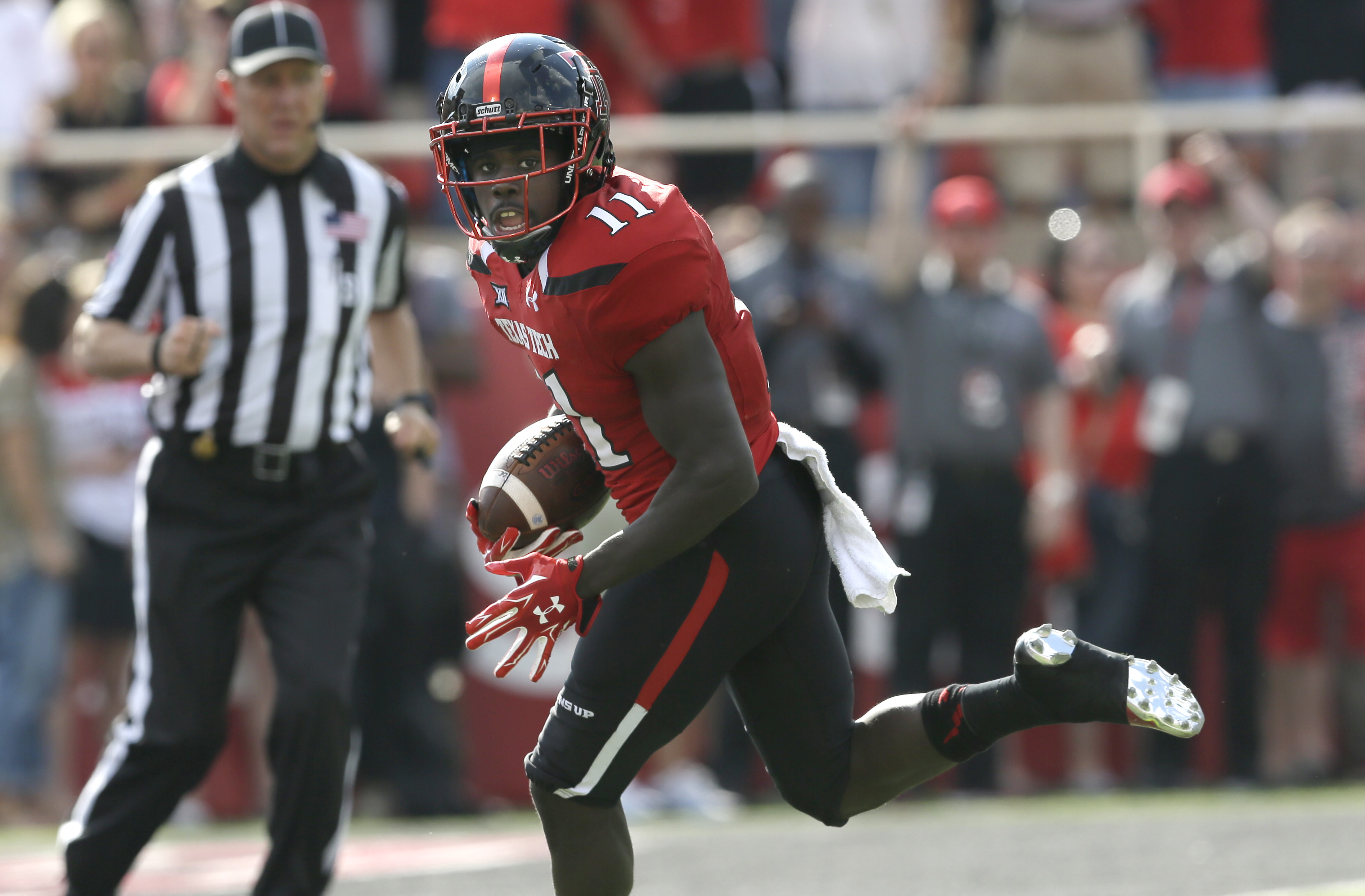 FILE - In this Sept. 26, 2015, file photo, Texas Tech wide receiver Jakeem Grant (11) runs in for a touchdown after a reception in the first half of an NCAA college football game against TCU in Lubbock, Texas. Baylor, West Virginia, Texas Tech and TCU all