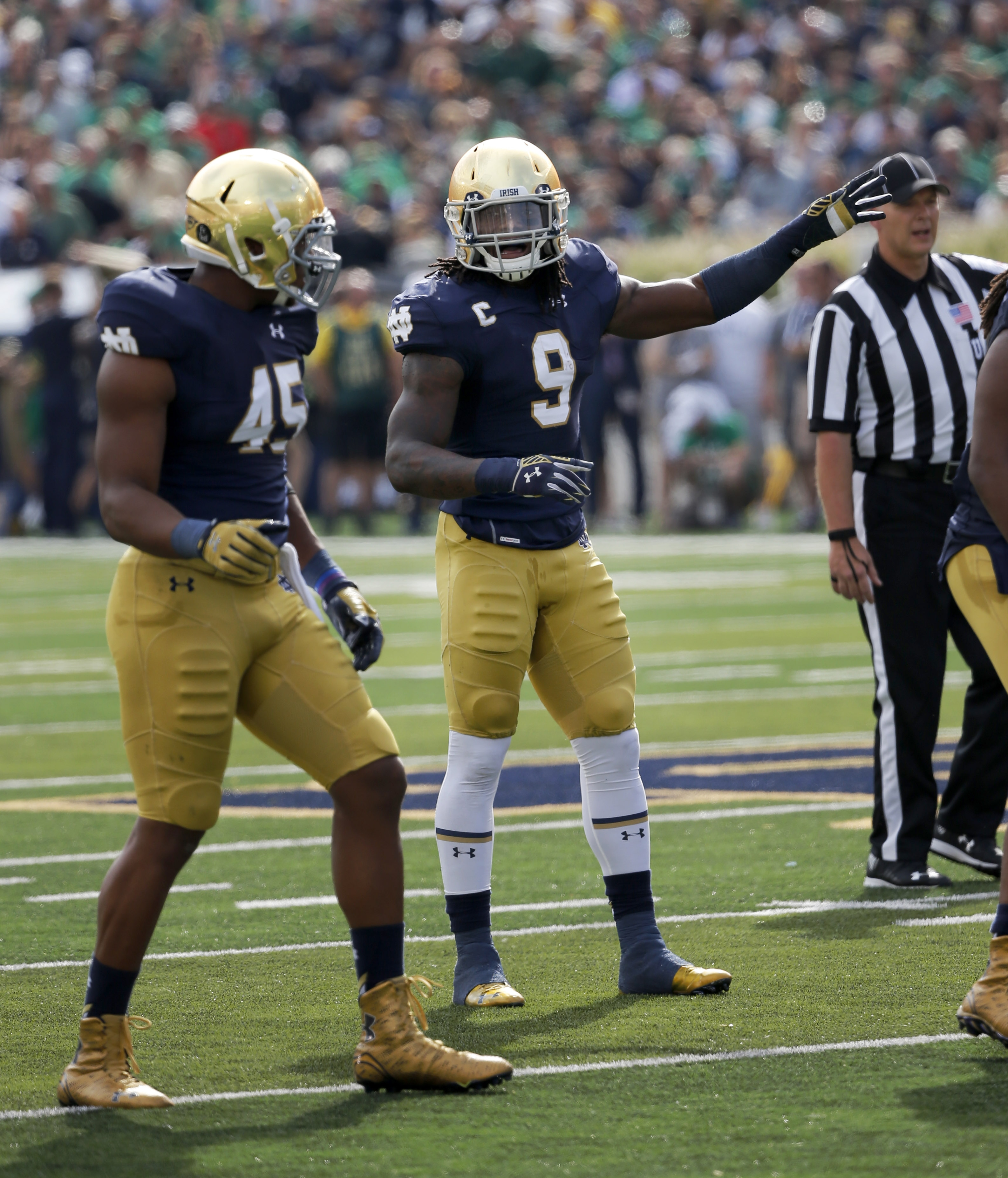 In this Saturday, Sept. 26, 2015 photo, Notre Dame linebacker Jaylon Smith calls out defensive alignments during the first half of an NCAA college football game against  Massachusetts, in South Bend, Ind. Jaylon Smith is hard to keep track of. Sometimes h