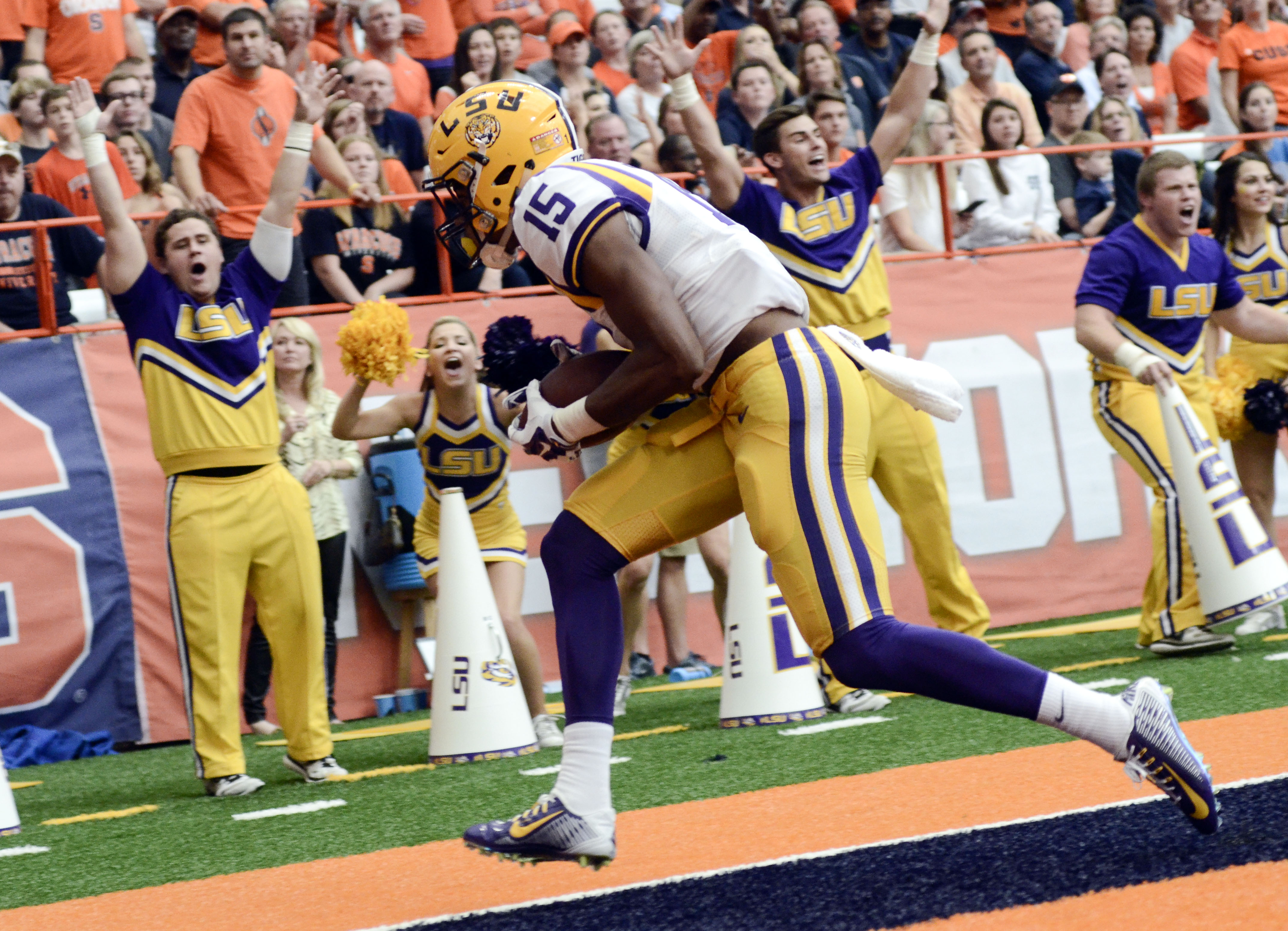 FILE - In this Sept. 26, 2015, file photo, LSU wide receiver Malachi Dupre (15) scores a touchdown during the second half of an NCAA college football game against Syracuse in Syracuse, N.Y. Dupre says he appreciates that the ninth-ranked Tigers can't look