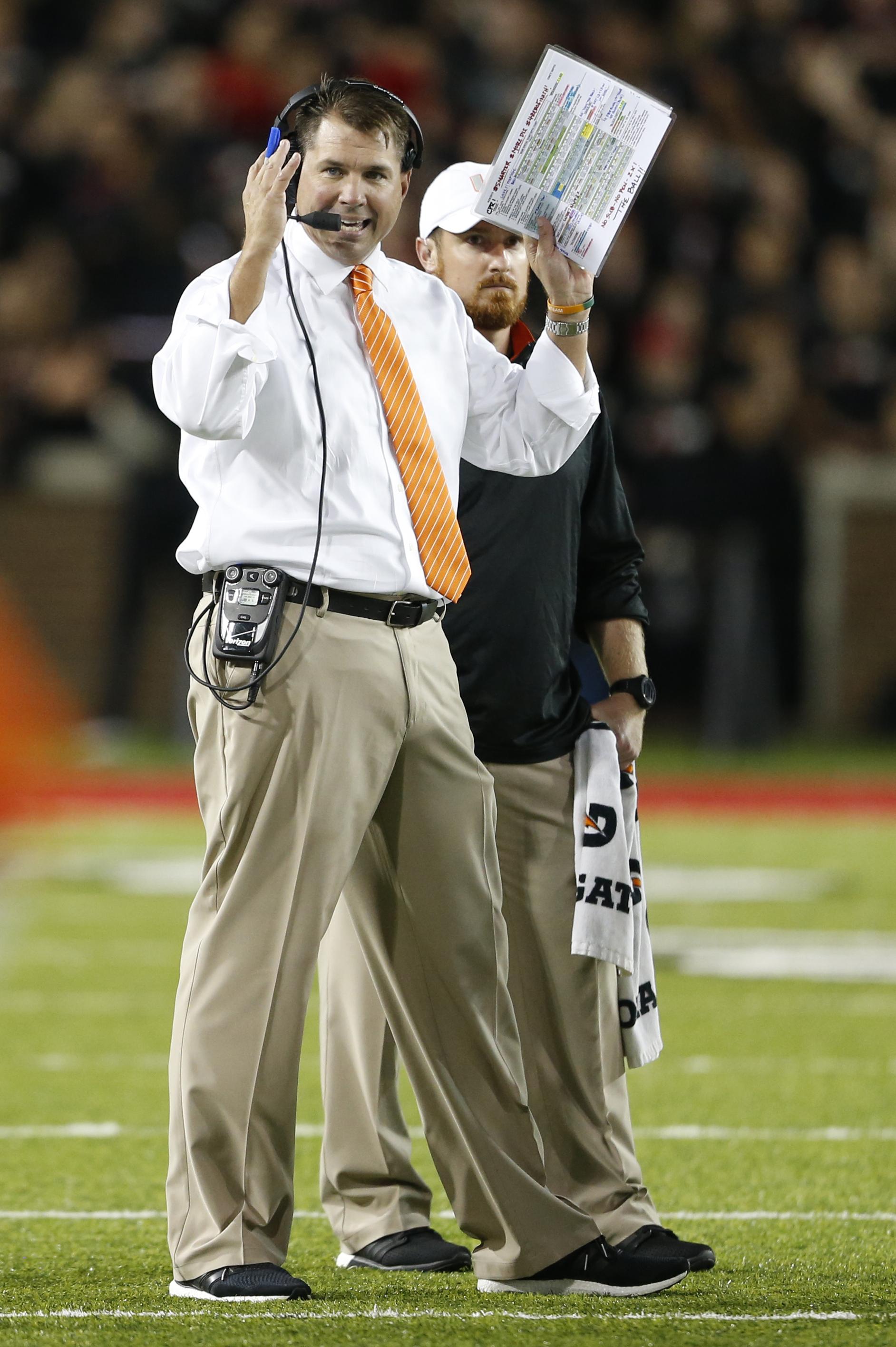 Miami head coach Al Golden gives instructions during the first half of an NCAA college football game against Cincinnati, Thursday, Oct. 1, 2015, in Cincinnati. (AP Photo/Gary Landers)