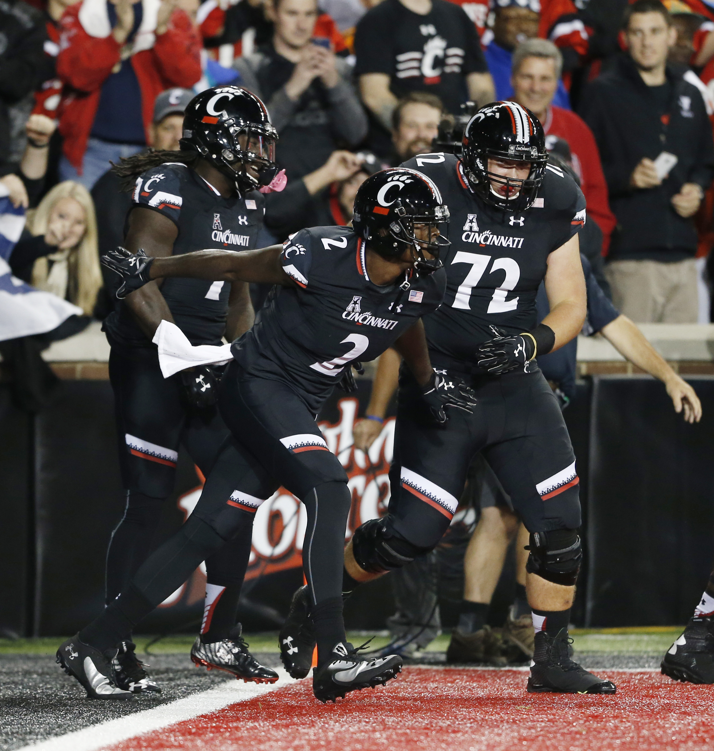 Cincinnati wide receiver Mekale McKay (2) celebrates a touchdown against Miami during the first half of an NCAA college football game, Thursday, Oct. 1, 2015, in Cincinnati. (AP Photo/Gary Landers)