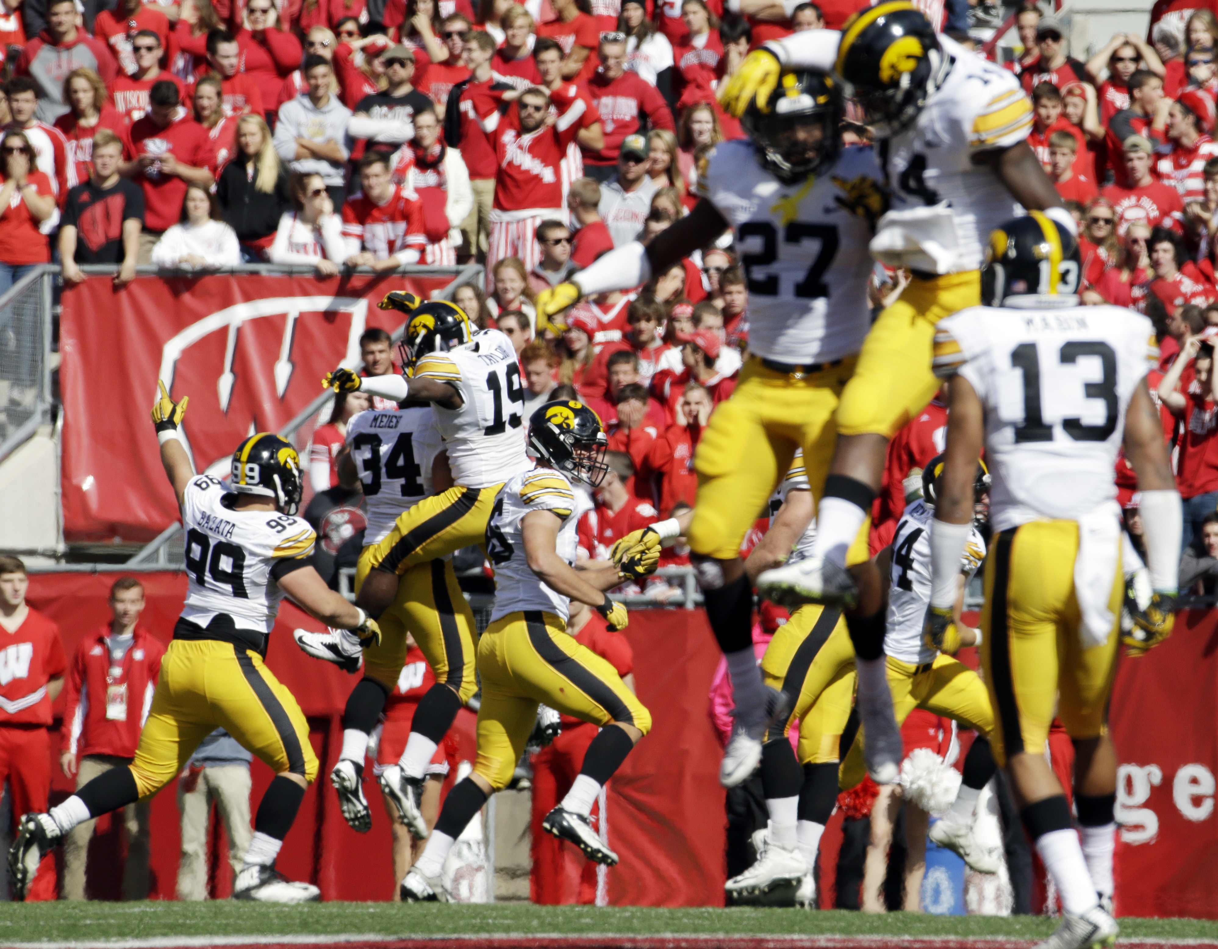 Iowa players celebrate after recovering a fumble during the first half of an NCAA college football game against Wisconsinm Saturday, Oct. 3, 2015, in Madison, Wis. (AP Photo/Morry Gash)